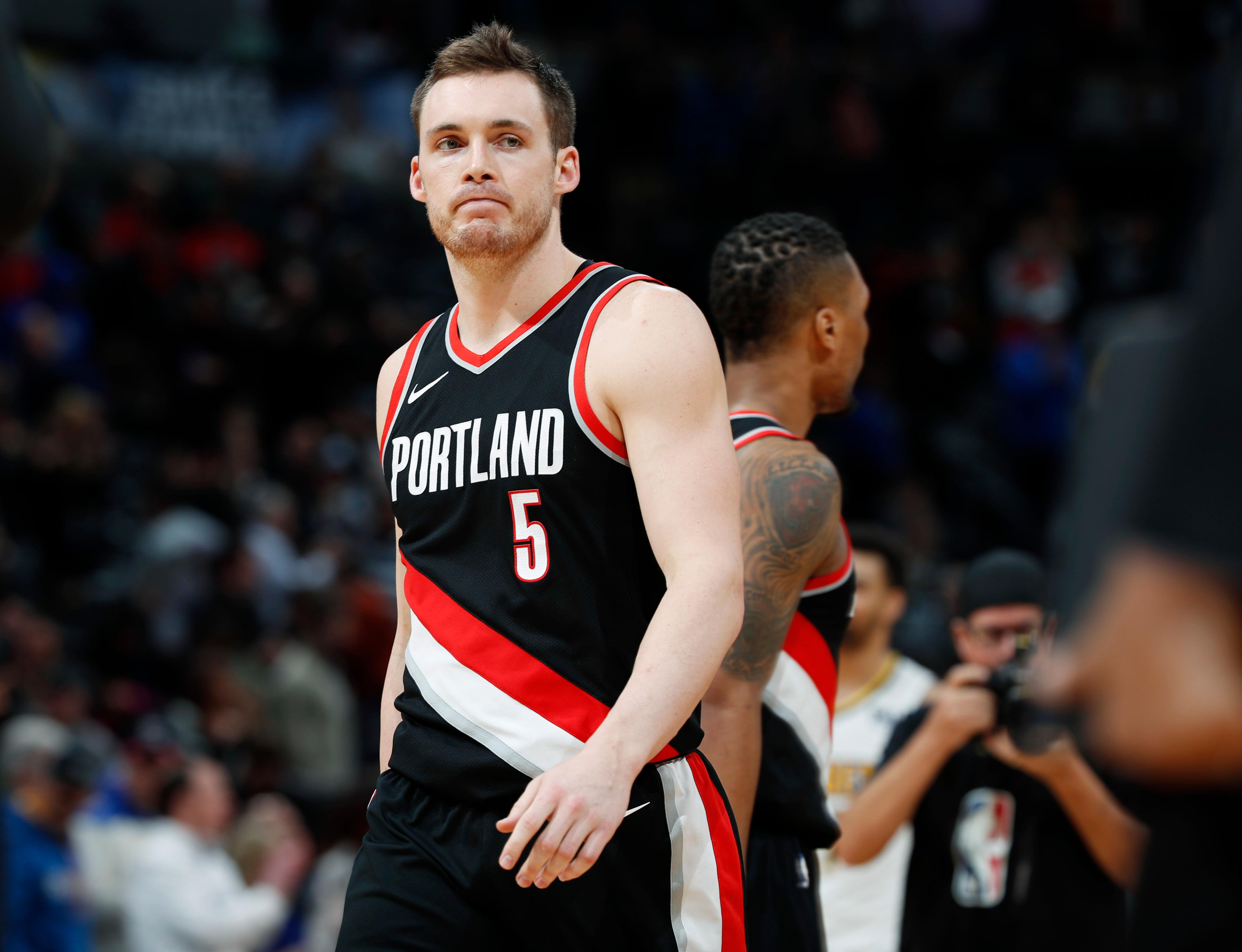 Portland Trail Blazers guard Pat Connaughton reacts as time runs out in the second half of an NBA basketball game against the Denver Nuggets Monday, Jan. 22, 2018, in Denver. The Nuggets 104-101. (AP Photo/David Zalubowski)