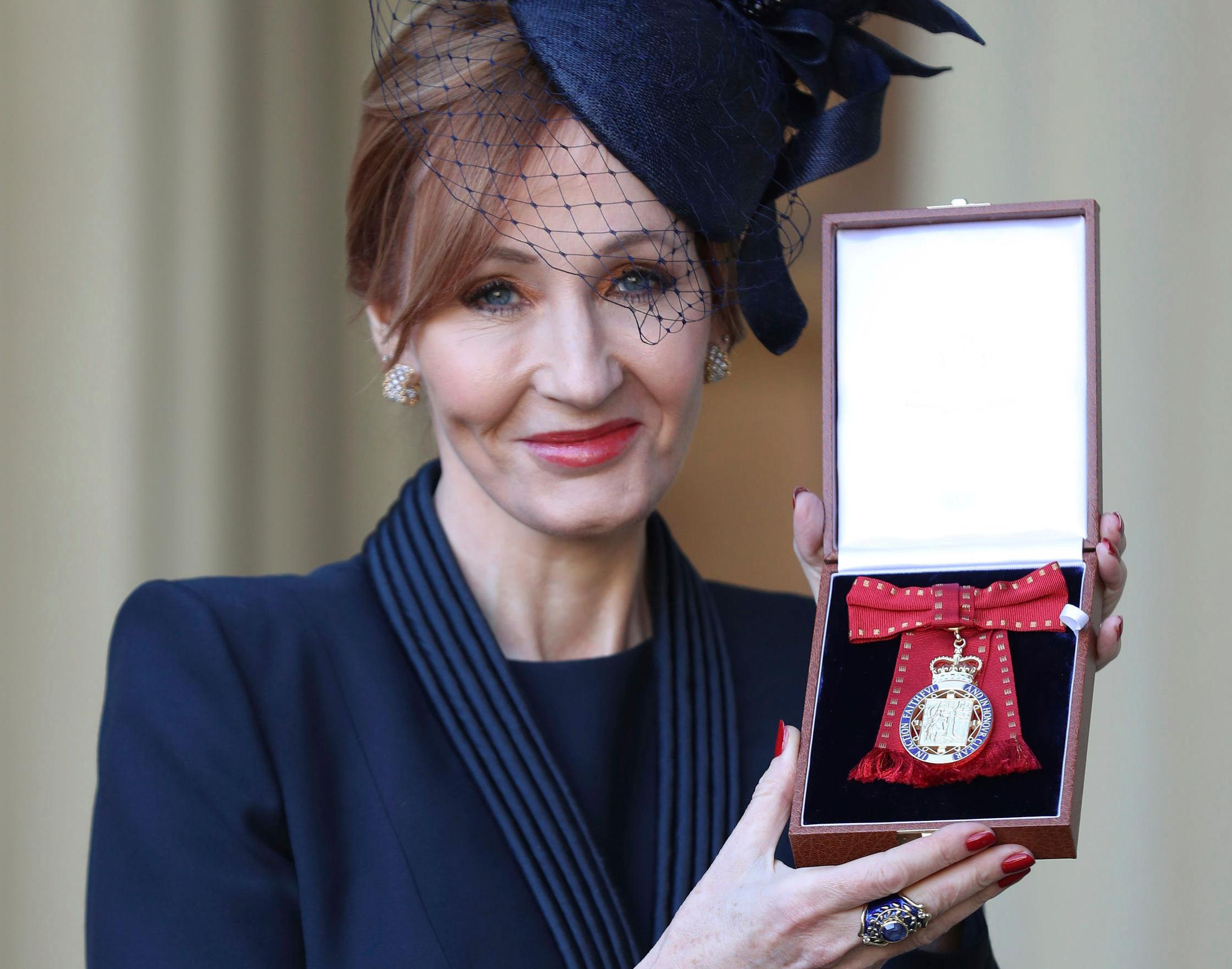 The author of the Harry Potter books,  JK Rowling poses after she was made a Companion of Honour during an Investiture ceremony at Buckingham Palace in London, Tuesday Dec. 12, 2017.  The Duke of Cambridge conducted the investiture for the honour. (Andrew Matthews/Pool via AP)