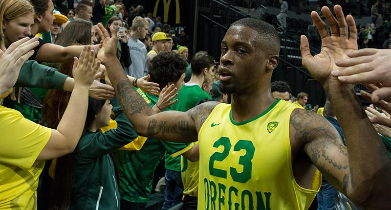 Oregon's Elgin Cook (#23) high-fives fans after the Ducks' win. Paced by 25 points from sophomore Dillon Brooks, Oregon defeated UCLA 86-72 in front of a crowd of 10,525 at Matthew Knight Arena on Saturday afternoon in Eugene, Oregon. With the win, the Ducks move to 16-4 on the season and 5-2 in PAC-12 play. Eric Cech, Oregon News Lab