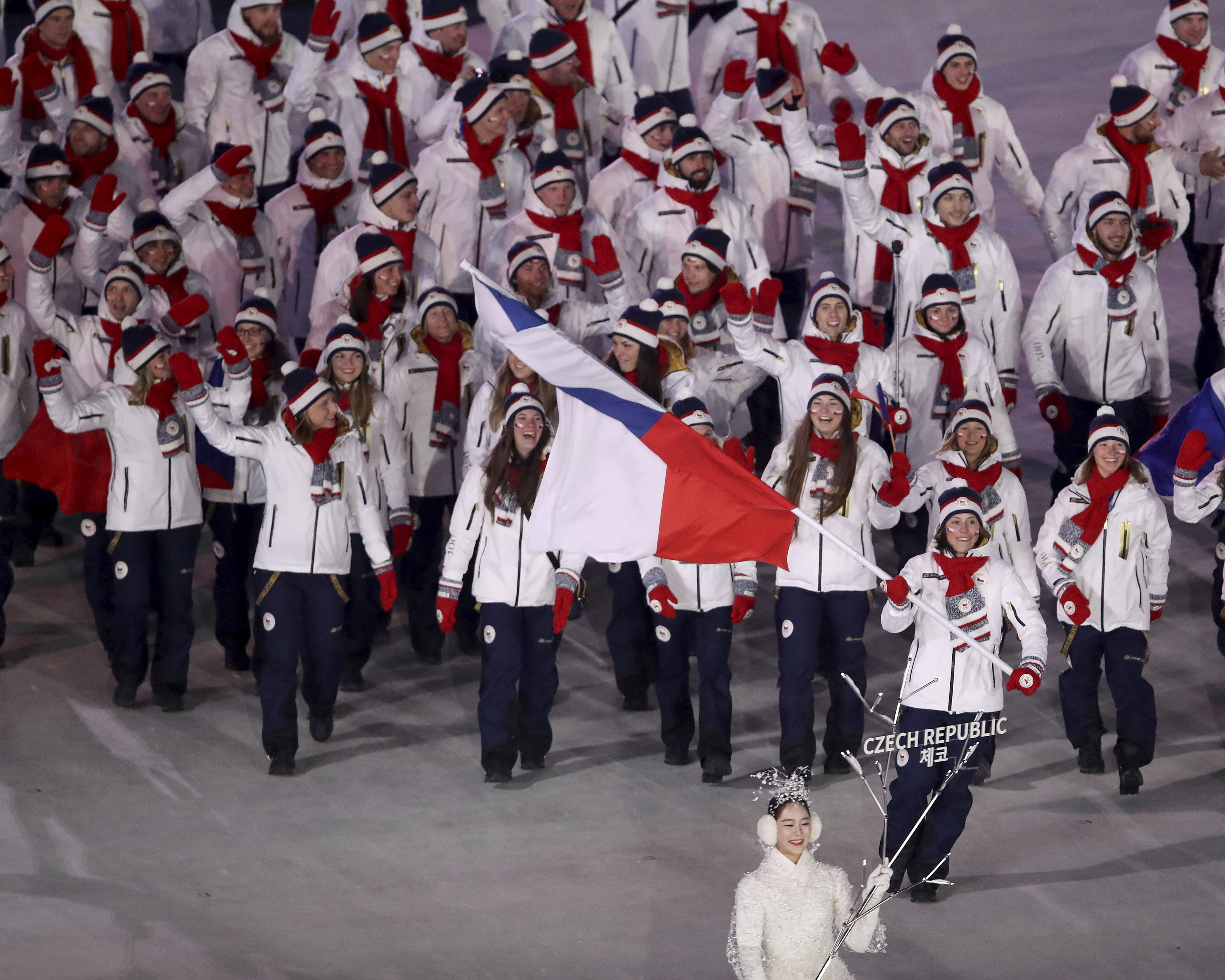 Eva Samkova carries the flag of the Czech Republic during the opening ceremony of the 2018 Winter Olympics in Pyeongchang, South Korea, Friday, Feb. 9, 2018. (Sean Haffey/Pool Photo via AP)