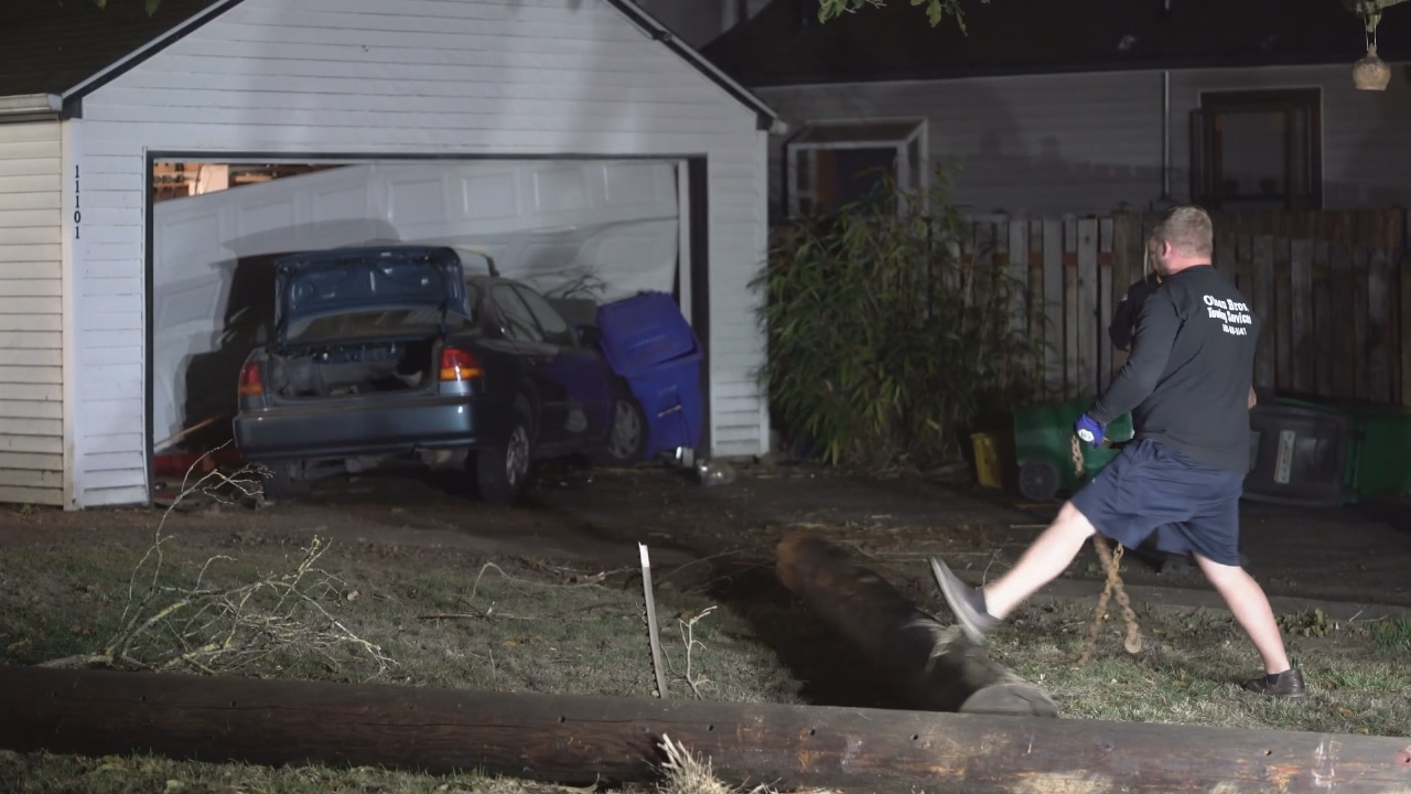 Milwaukie police say officers were pursuing a driver in a stolen vehicle when the driver crashed into a garage in Southeast Portland. KATU photo