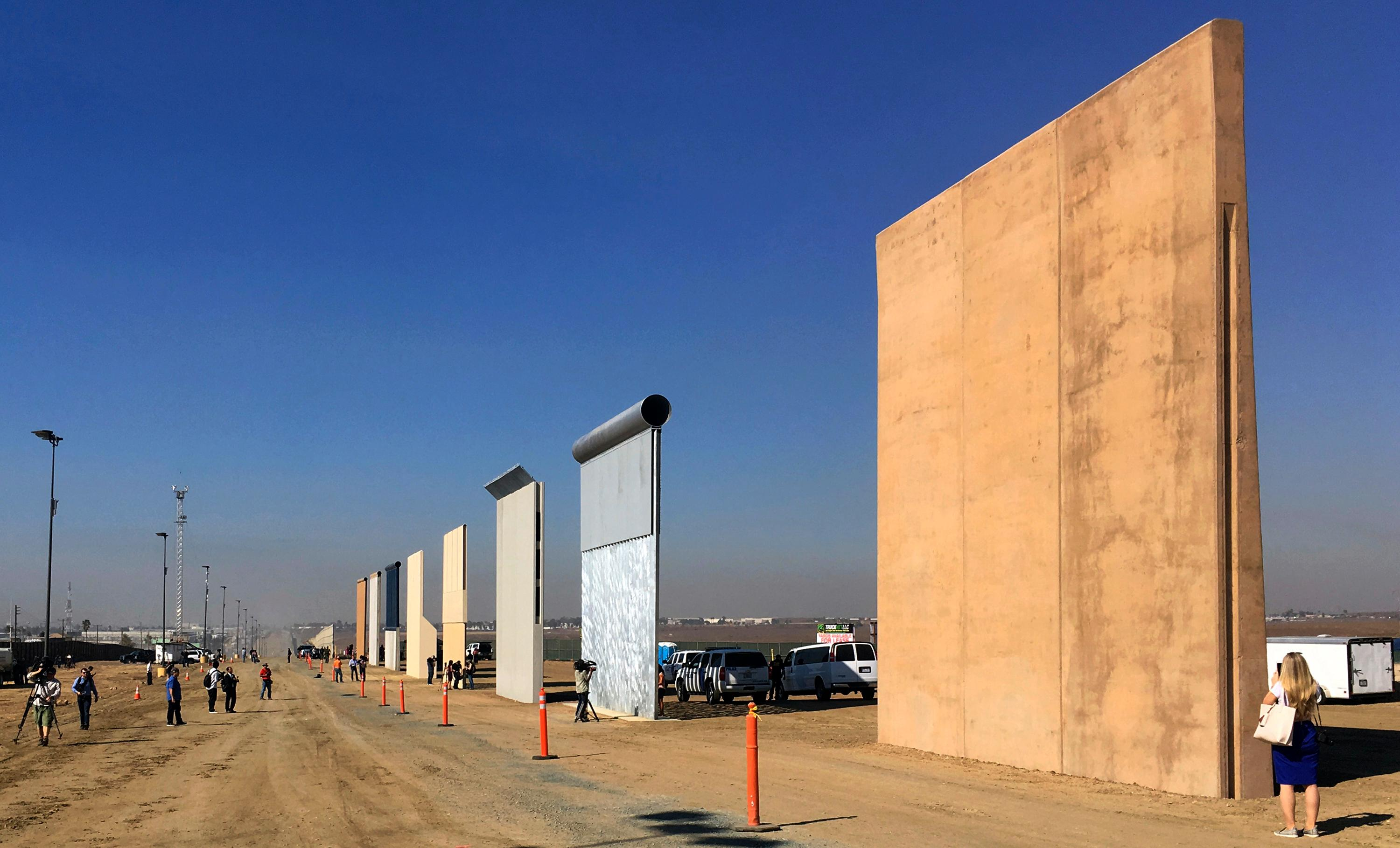 FILE - This Oct. 26, 2017 file photo shows prototypes of border walls in San Diego. The Trump administration has proposed spending $18 billion over 10 years to significantly extend the border wall with Mexico. (AP Photo/Elliott Spagat, File)<p></p>