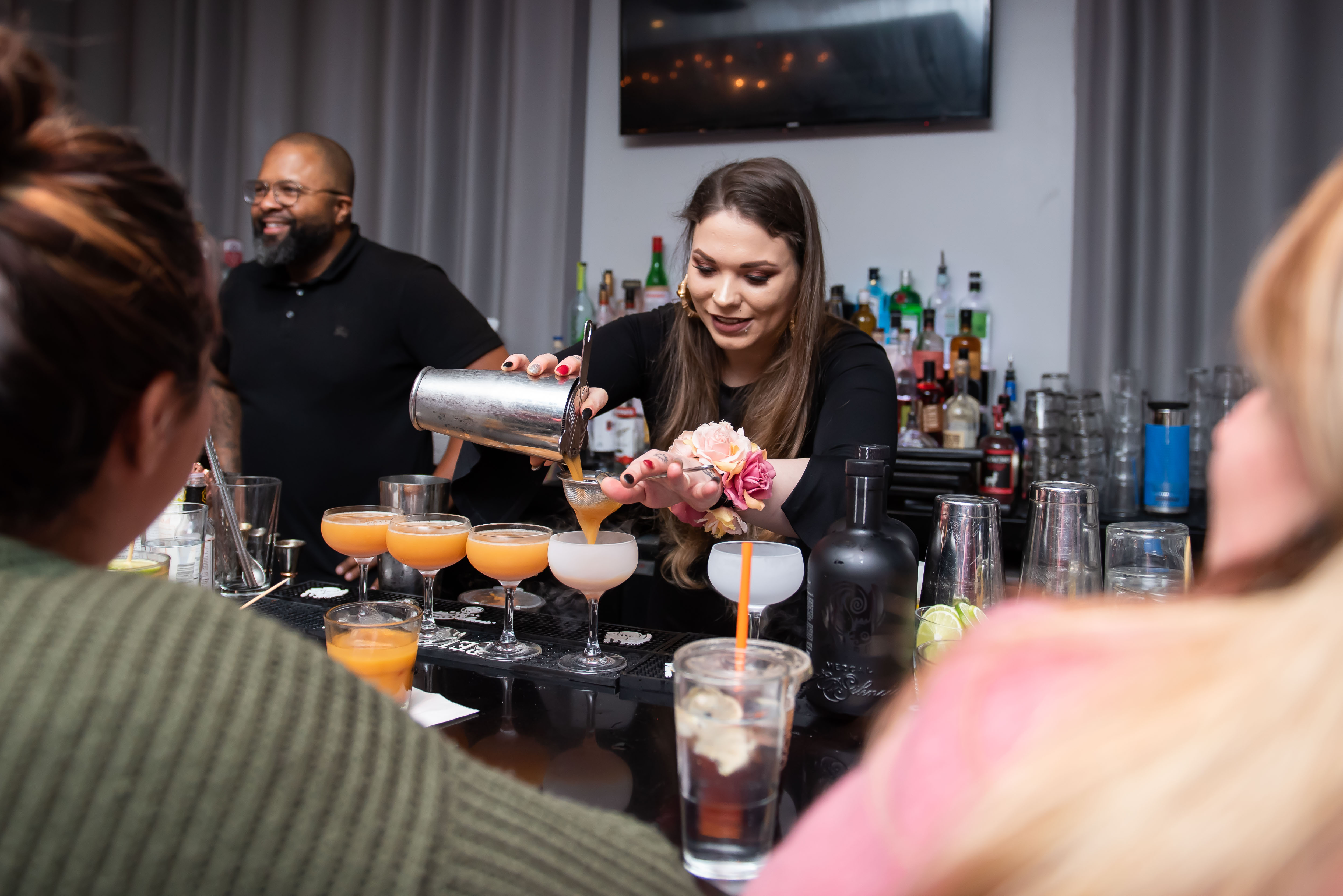 "On Sunday, January 20, 2019, eight professional D.C. bartenders competed for the coveted title of ""Top Dog"" in a craft cocktail competition at Capo Deli and Speakeasy to benefit The Humane Rescue Alliance.{ } The contestants (Ethan Fellers, Kyle Fuller, Marcus McPhail, Mai Templeton, Richard Torres, Keith Vinlaun, Jazmyne Wade and Sonya Znati) were judged by celeb judges, Chef Amy Brandwein, Chef Kwame Onwuachi, Himtsu co-owner Carlie Steiner and spirits writer M. Carrie Allan. The competition? Who can craft the best cocktail using Blue Henry syrups, cotton candy butters, dried fruit garnishes or Silencio mezcal in a tournament-style round of matchups. Service Bar's Mai Templeton emerged the ""Top Dog"" winner, while Richard Torres (Silver New American Brasserie) took home the People's Choice Award. (Image: Joy Asico / DC Refined)"