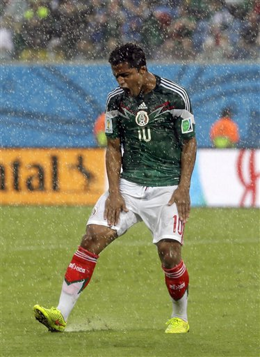Mexico's Giovani dos Santos reacts after his goal was disallowed during the group A World Cup soccer match between Mexico and Cameroon in the Arena das Dunas in Natal, Brazil, Friday, June 13, 2014.