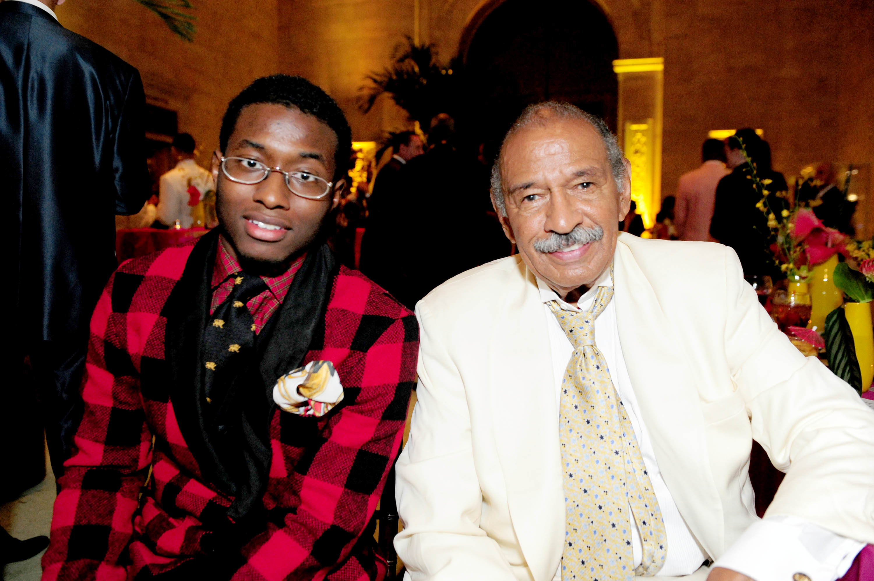 In this July 16, 2011 photo, John Conyers, III poses with his father Rep. John Conyers, D-Mich., in Detroit. John Conyers' resignation from the U.S. House amid sexual harassment allegations unlocks the seat he's held for more than a half-century. The 88-year-old endorsed his son, political neophyte John Conyers III. (Ricardo Thomas /Detroit News via AP)