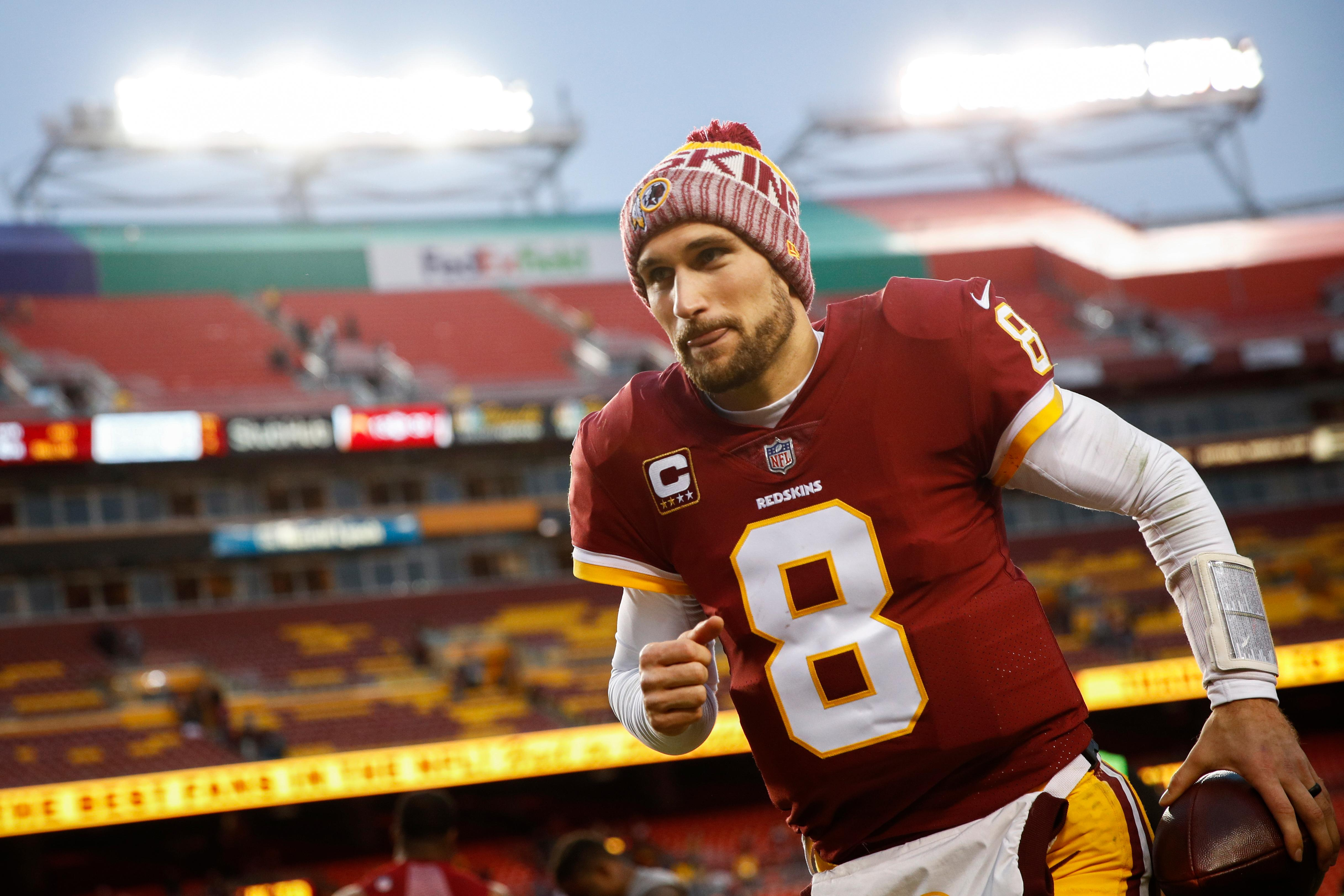 Washington Redskins quarterback Kirk Cousins (8) runs off the field after an NFL football game against Arizona Cardinals in Landover, Md., Sunday, Dec 17, 2017. The Redskins defeated the Cardinals 20-15. (AP Photo/Patrick Semansky)