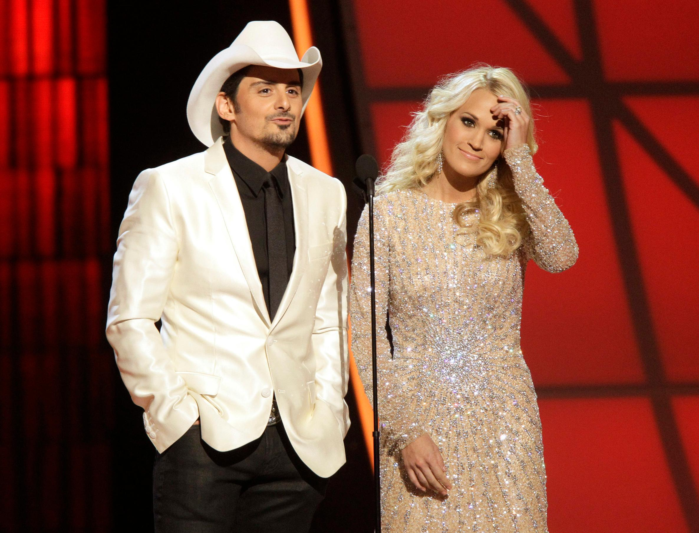FILE - In this Nov. 1, 2012 file photo, hosts Brad Paisley, left, and Carrie Underwood appear at the 46th Annual Country Music Awards in Nashville, Tenn. (Photo by Wade Payne/Invision/AP, File)<p></p>