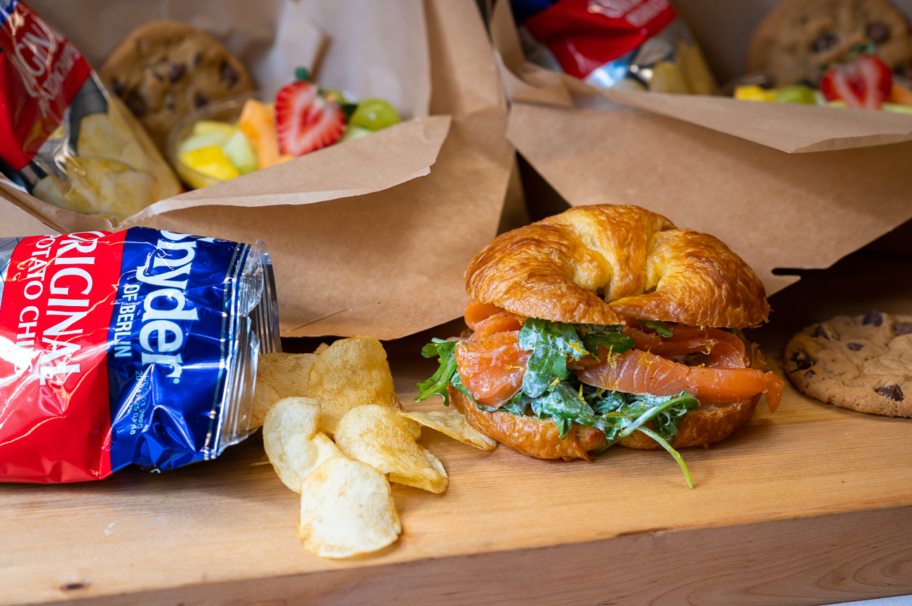 Their boxed lunches are available through the end of the year. Pictured: Atlantic cold-smoked salmon (done in-house!) with arugula, lemon, capers, and chives on a fresh croissant. Each boxed lunch comes with a bagged snack, cookie, and fruit salad. / Image: Phil Armstrong, Cincinnati Refined // Published: 11.6.20