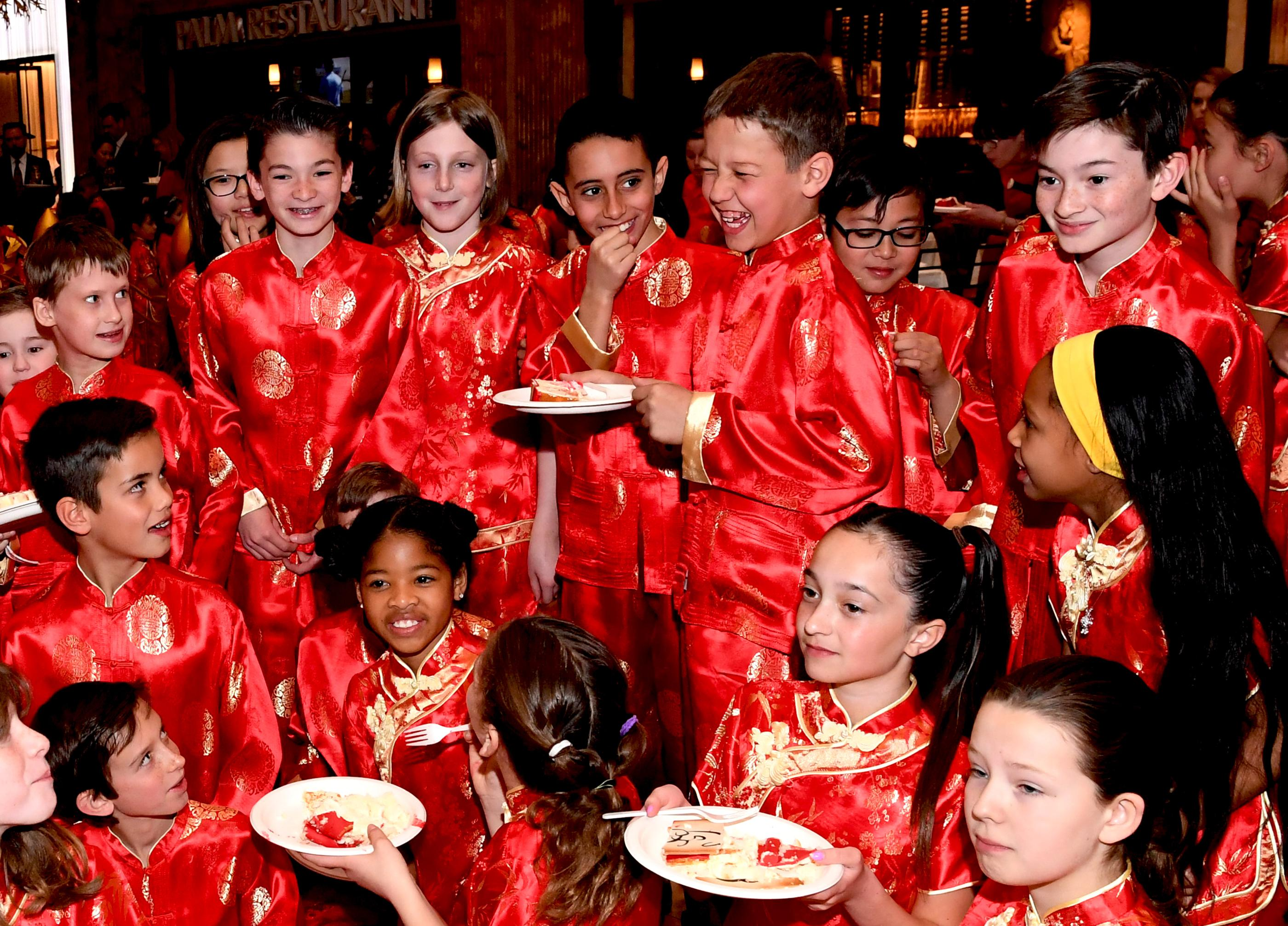 Meadows School 22nd Annual Dragon Parade in honor of Chinese New Year, the Year of the Dog, at Caesars Forum Shops. At the end of the parade students are treated to a surprise Year of the Dog cake from Freed's Bakery. Thursday, February 16, 2018. CREDIT: Glenn Pinkerton/Las Vegas News Bureau