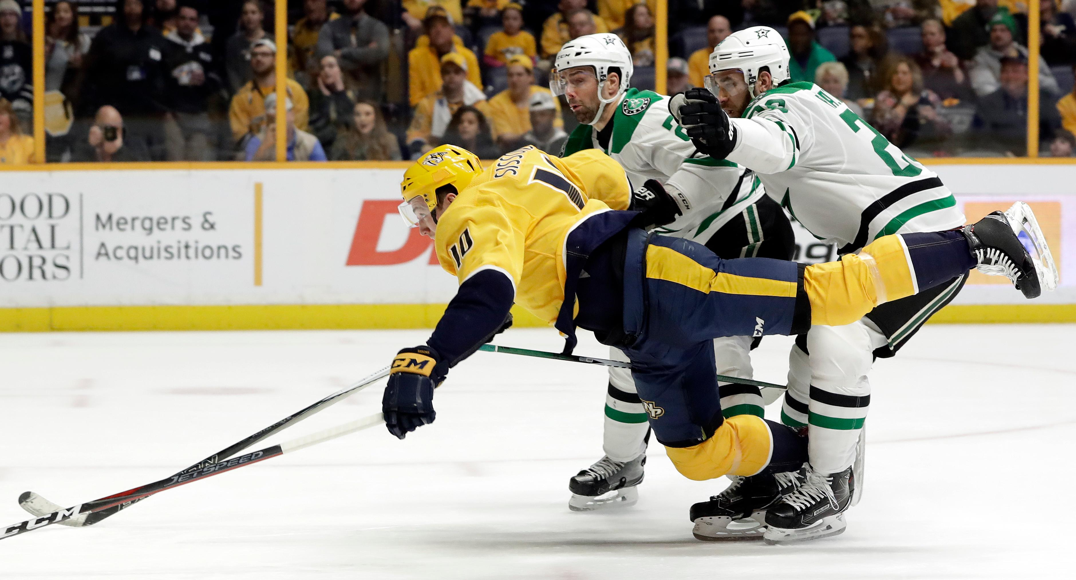 Dallas Stars defenseman Greg Pateryn, right takes down Nashville Predators center Colton Sissons (10) in the second period of an NHL hockey game Tuesday, March 6, 2018, in Nashville, Tenn. Pattern was penalized for holding. (AP Photo/Mark Humphrey)