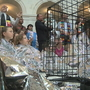 Children fill Senate rotunda wrapped in Mylar jackets to protest immigration detentions