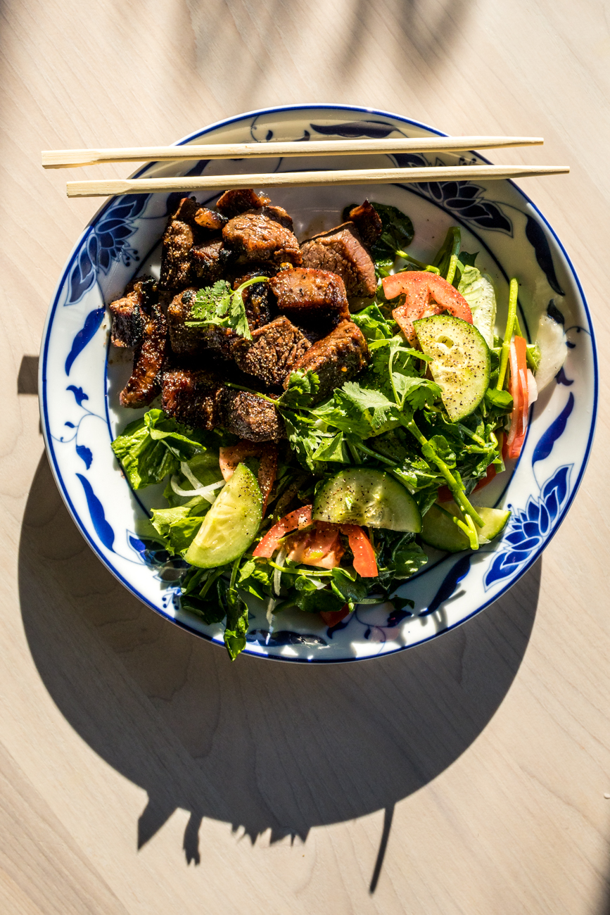Bo Luc Lac (Shaken Beef): (available for dinner only) sautéed cubes of Waygu flank steak cooked medium with a sweet and savory marinade accompanied by a watercress salad with a simple vinaigrette / Image: Catherine Viox // Published: 12.28.19