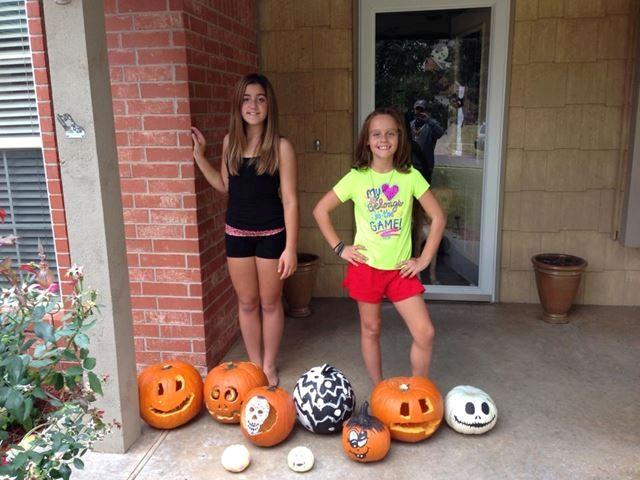 Painted and carved pumpkins, happy girls