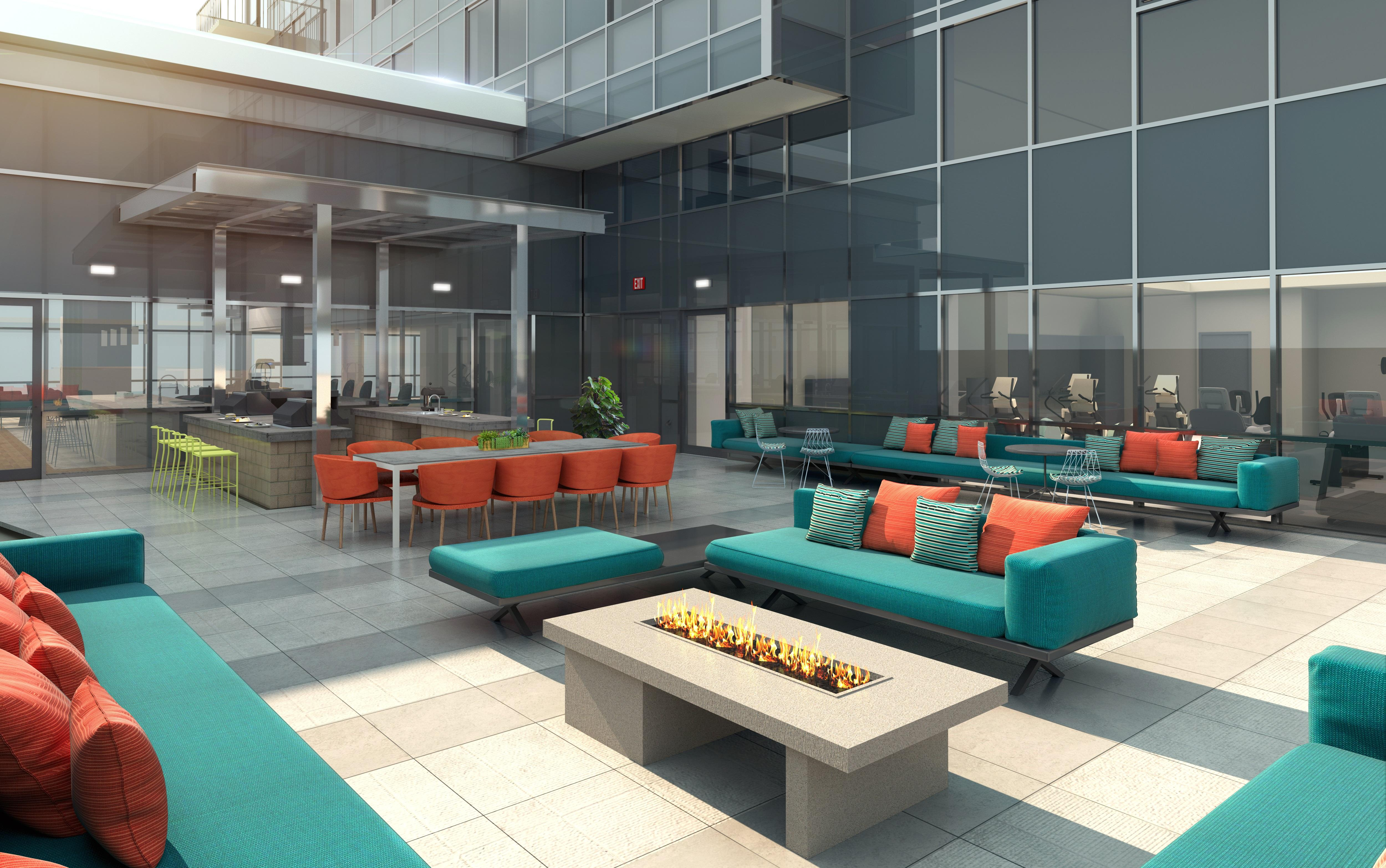 The Collection patio at The Danforth features an outdoor kitchen and lounge seating.