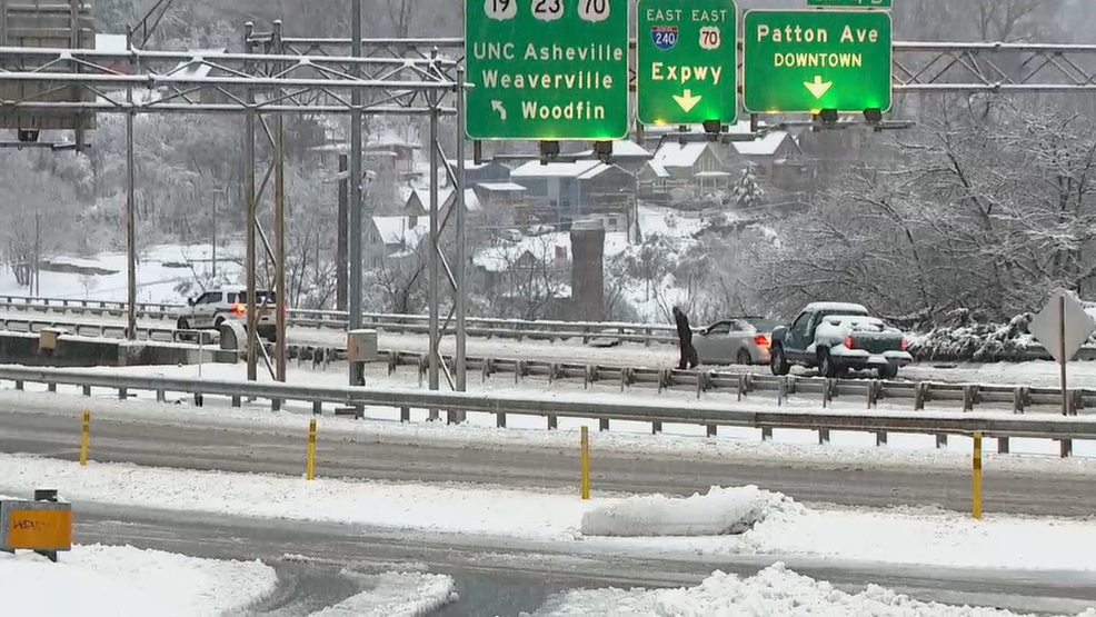 Asheville crews continue plowing efforts, suspend ART bus service