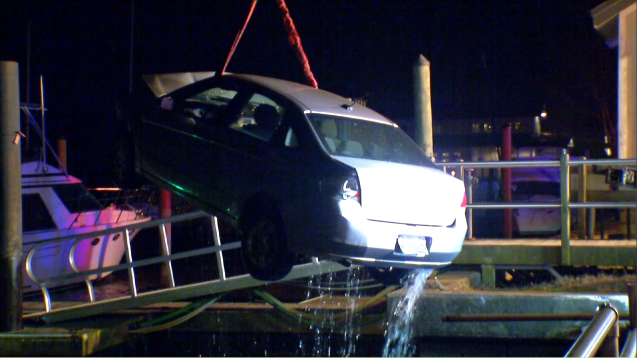 Crews pulled the car out of the Neuse after the driver, whose name has not been released, veered off the road near the Persimmons Waterfront Restaurant parking lot. (Greg Payne, NewsChannel 12 photo)