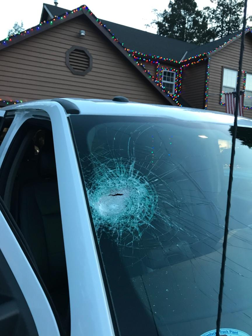 Photos of a vehicle damaged by someone tossing a rock at passing cars on Interstate 5 southbound exit to Interstate 205 - Oregon State Police photo<p></p>