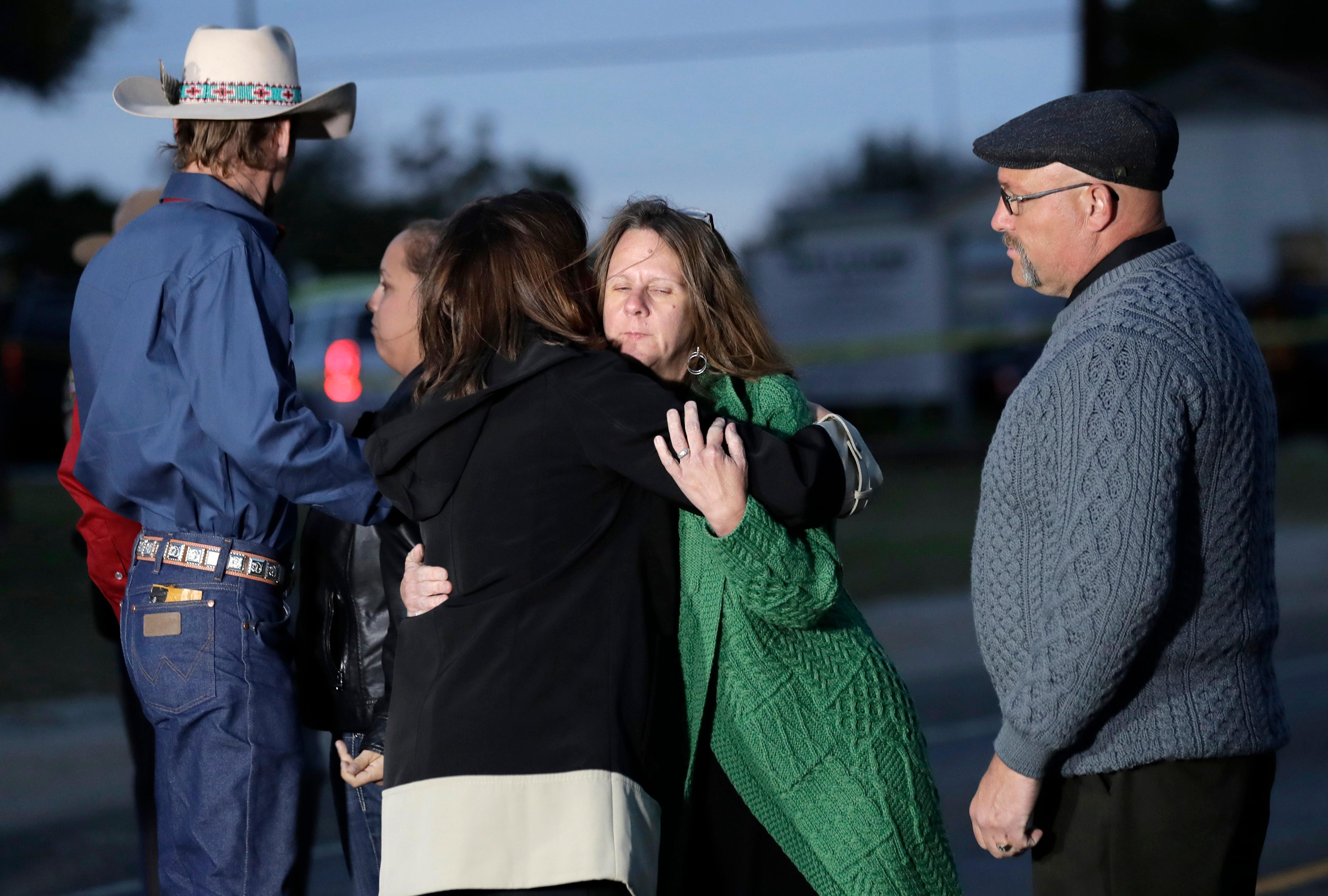 Second Lady Karen Pence, center, hugs Sherri Pomeroy as her husband, Pastor Frank Pomeroy, stands at right, outside the Sutherland Spring Baptist Church during a stop, Wednesday, Nov. 8, 2017, in Sutherland Springs, Texas. A man opened fire inside the church in the small South Texas community on Sunday, killing and wounding many. (AP Photo/Eric Gay)