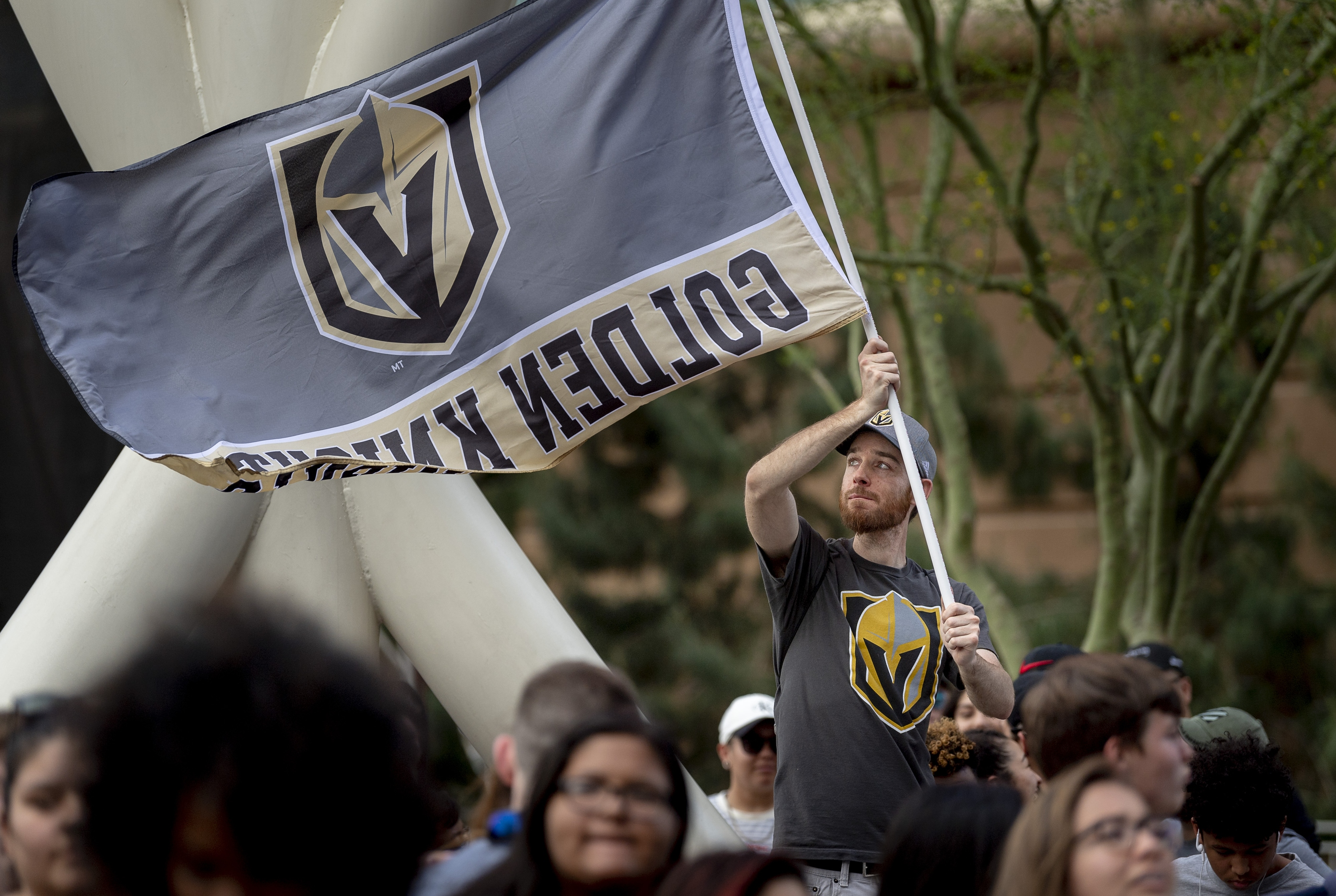 A fan unfurls his banner in the pre-game celebration in Toshiba Plaza as the Vegas Golden Knights prepare to meet the Los Angeles Kings in the first quarterfinal game of the NHL Stanley Cup Playoffs at T-Mobile Arena in Las Vegas on Wednesday, April 11, 2018.  CREDIT: Mark Damon/Las Vegas News Bureau