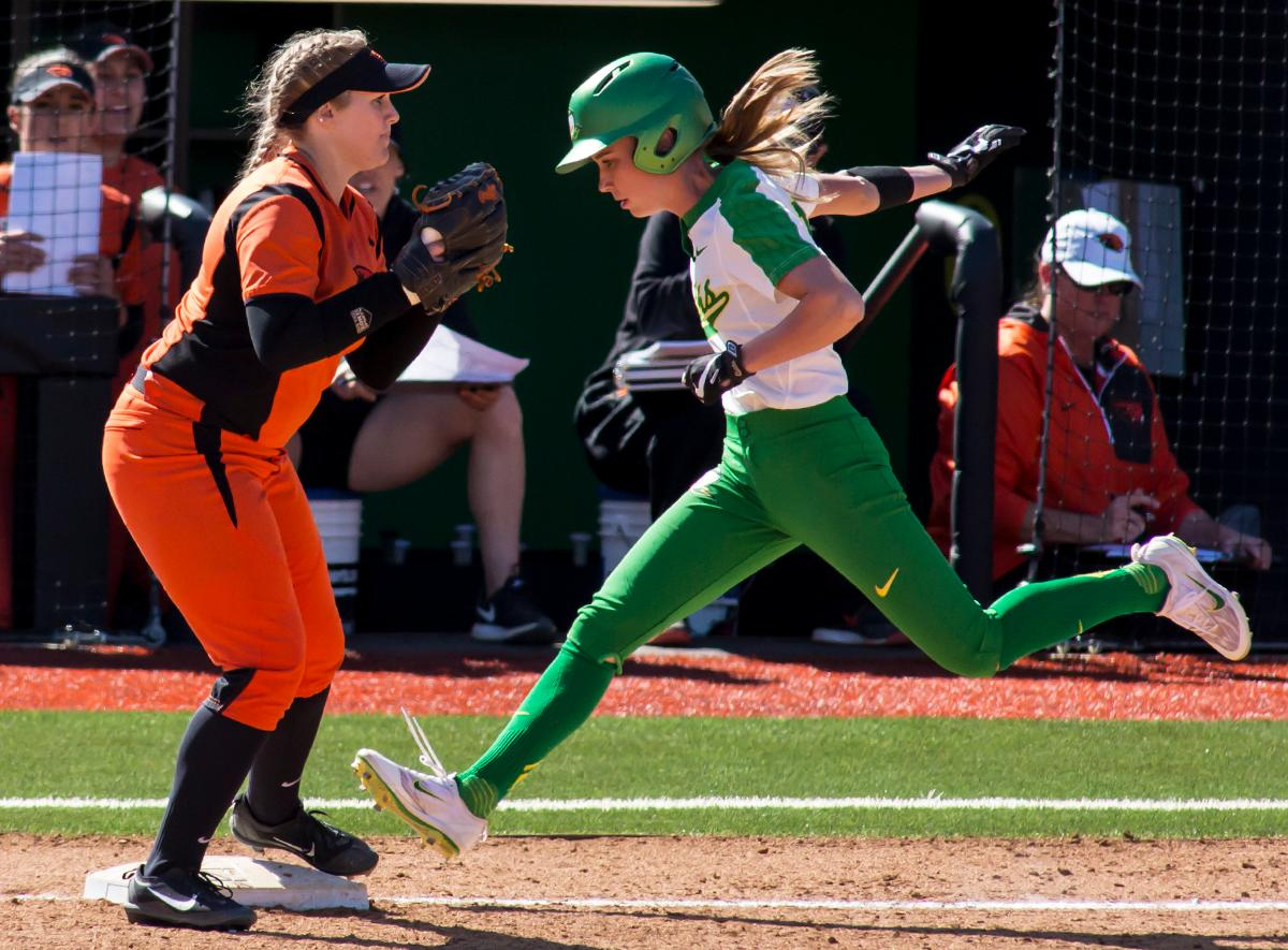 Oregon left fielder Alexis Mack (#10) races the ball to first base. The Oregon Ducks defeated the Oregon State Beavers seven to zero on Sunday, April 30, 2017. The Ducks' victory marked the third victory of the three game sweep against the Beavers. Photo by Ben Lonergan, Oregon News Lab