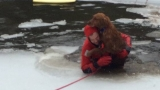Firefighters rescue dog from frozen backyard pond