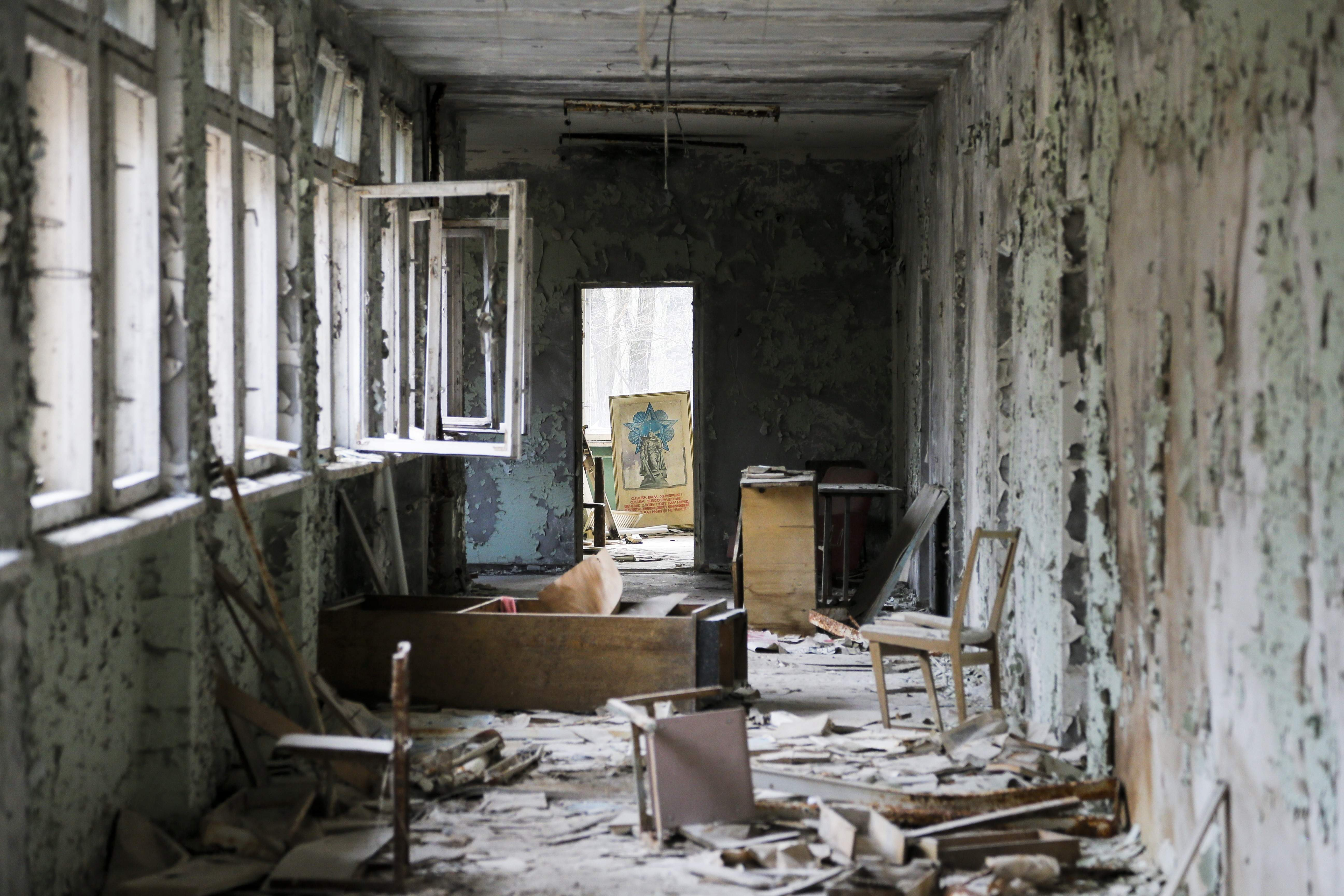 This photo taken Wednesday, April 5, 2017, shows a room in a dilapidated building, part of a school in the deserted town of Pripyat, some 3 kilometers (1.86 miles) from the Chernobyl nuclear power plant Ukraine. Once home to some 50,000 people whose lives were connected to the Chernobyl nuclear power plant, Pripyat was hastily evacuated one day after a reactor at the plant 3 kilometers (2 miles away) exploded on April 26, 1986. The explosion and the subsequent fire spewed a radioactive plume over much of northern Europe. THE ASSOCIATED PRESS