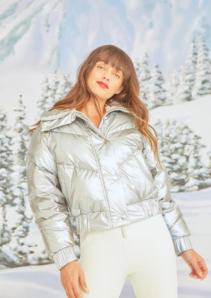 The Snowbird cropped down jacket is the perfect third layering piece. The oversized silhouette and maximum duck down fill accentuate the waist while providing ultimate warmth. The statement collar is insulated to maintain shape and style while protecting the face. Interior pockets keep necessities secure.  Italian waterproof metallic down shell fabric makes a dramatic statement, whether on the ski slope or enjoying an apres moment.{ } $980 (Image: Cordova){ }