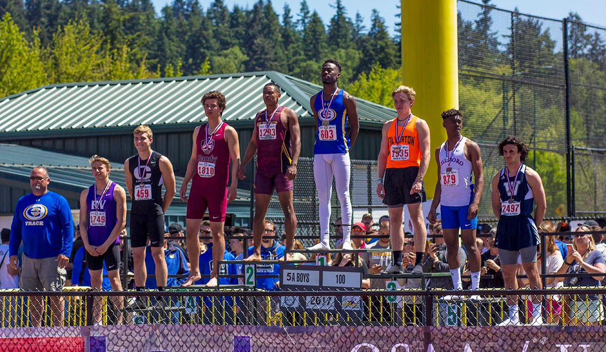 The 2017 OSAA State Track and Field Championships were on Saturday at Hayward Field. The 5A Boys take the podium after the 100 Meter Dash where Anthony Gray of Eagle Point High School takes first with a time of 10.79. Photo By: Stephanie Cusano, Oregon News Lab
