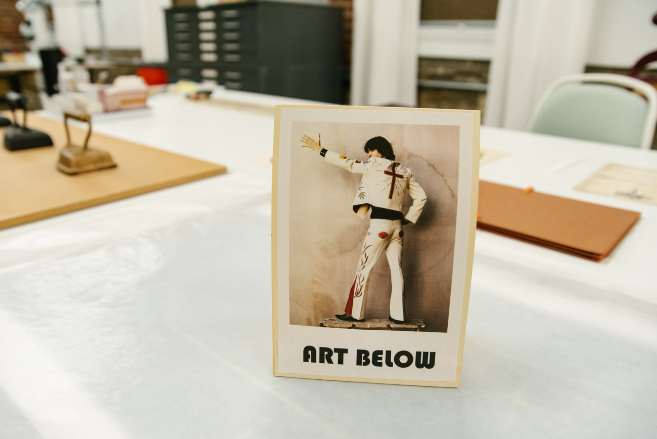 "A variety of ""Art Below"" signs can be found throughout the Strange Stock studio to signify a piece underneath that's in process. / Image: Melissa Sliney{ }// Published: 9.7.19"