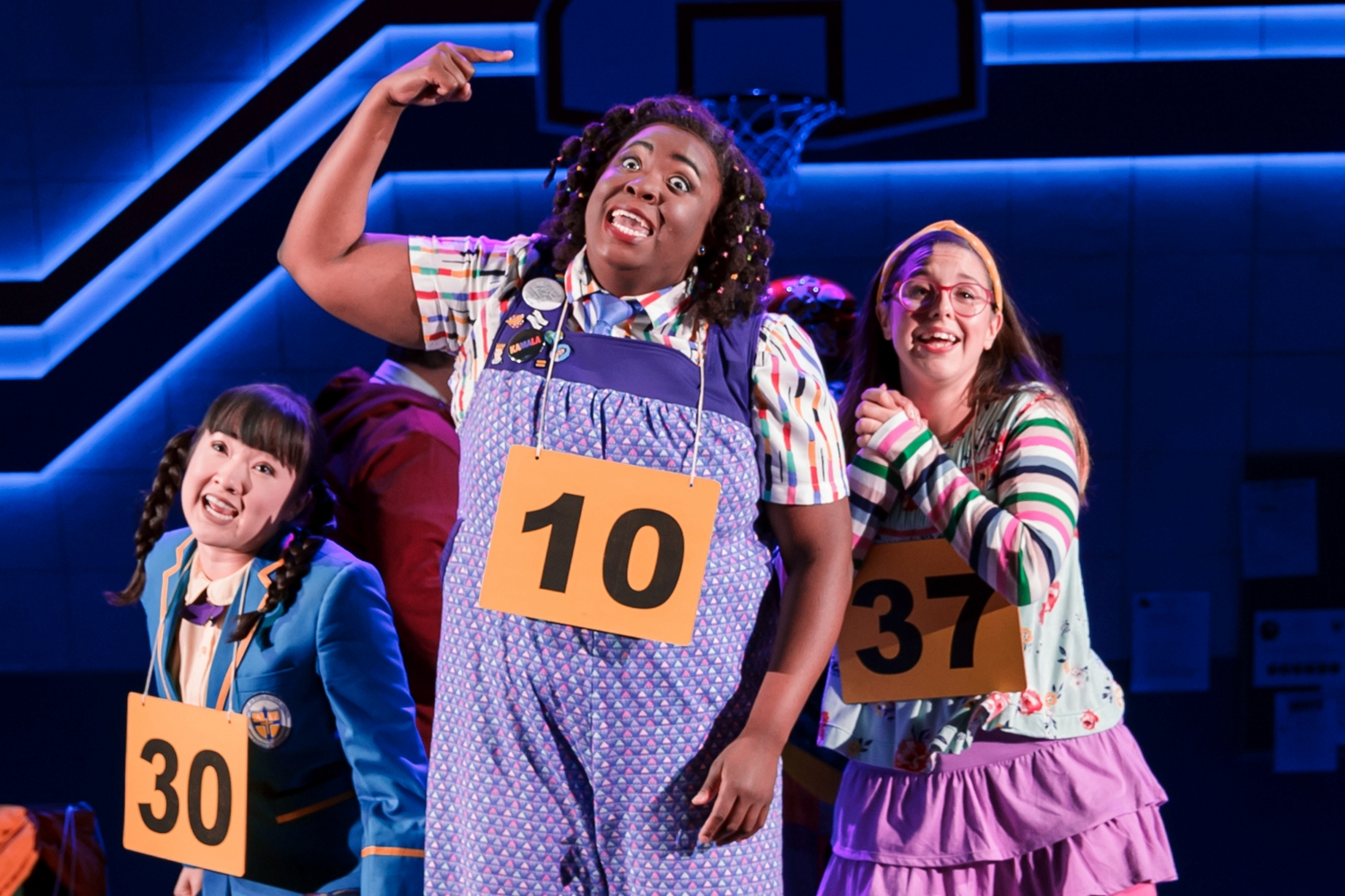 "Arika Matoba (Marcy Park), Sarah Russell (Logainne Schwartzandgrubenniere), and Taylor Niemeyer (Olive Ostrovsky) in ""The 25th Annual Putnam County Spelling Bee."" (Image: Mark Kitaoka/Village Theatre)"