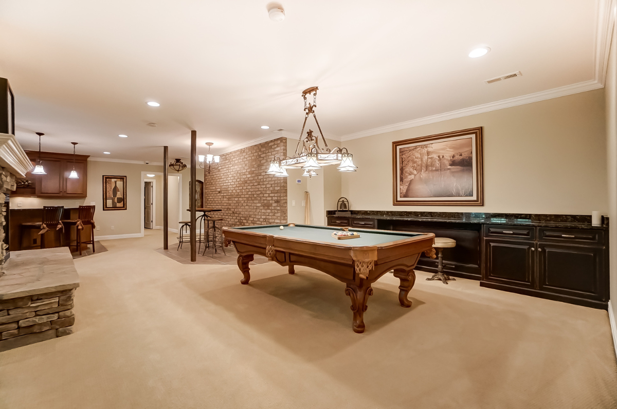The home offers a variety of unique spaces including an office, game room, home theater, finished basement, and massive closets. There's also an in-home hair salon with a beautician's chair and sink. / Image courtesy of Wow Video Tours via Michael Franz of Coldwell Banker West Shell-Hyde Park // Published: 9.7.20