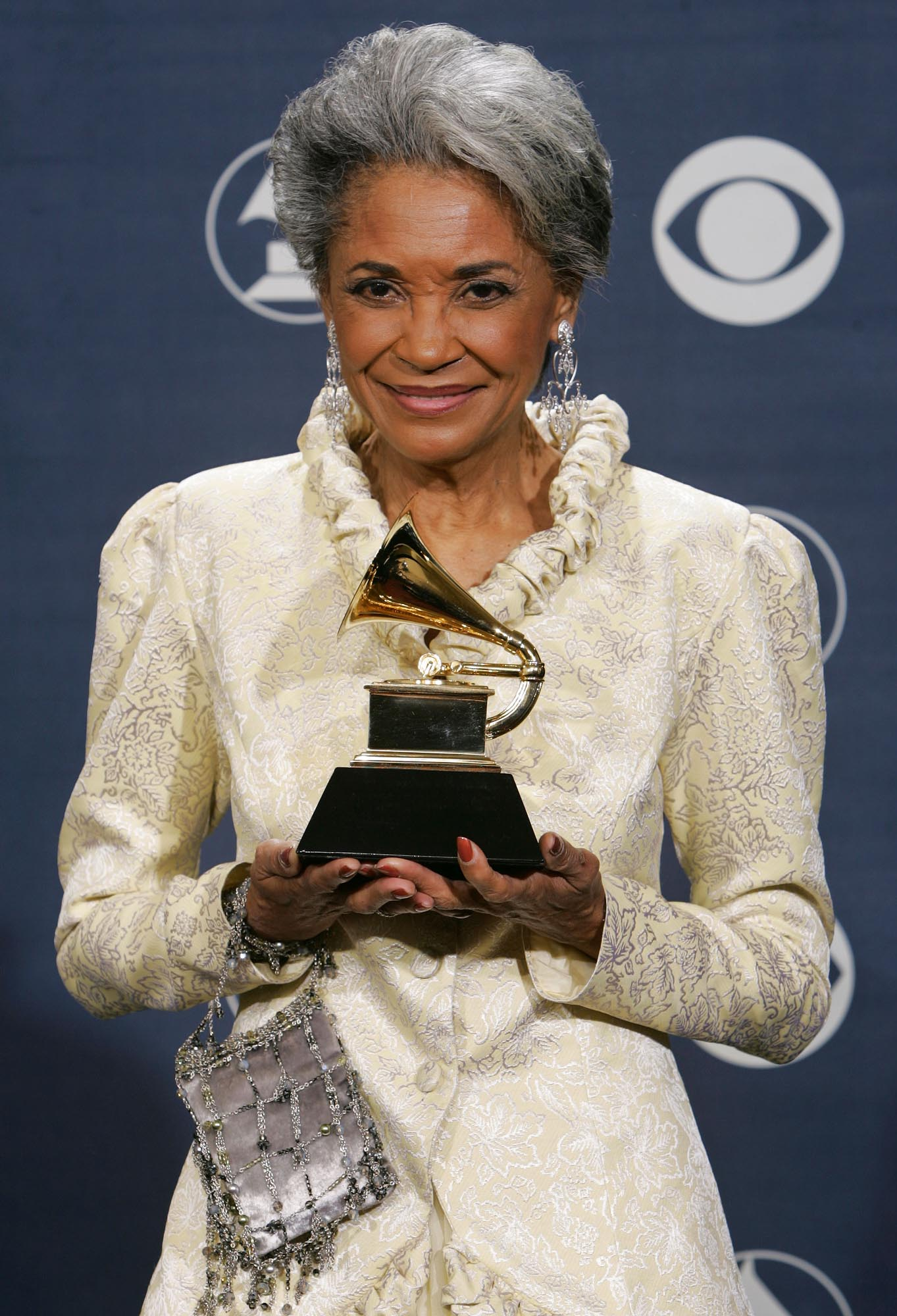 "Nancy Wilson poses with her award for best jazz vocal album for ""R.S.V.P. (Rare Songs, Very Personal)"" at the 47th Annual Grammy Awards  Sunday, Feb. 13, 2005, in Los Angeles. (AP Photo/Reed Saxon)"