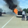 Video: Commuter helps woman away from burning car on I-75