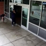 Caught on video: Cop tackles bat-wielding suspect outside police station