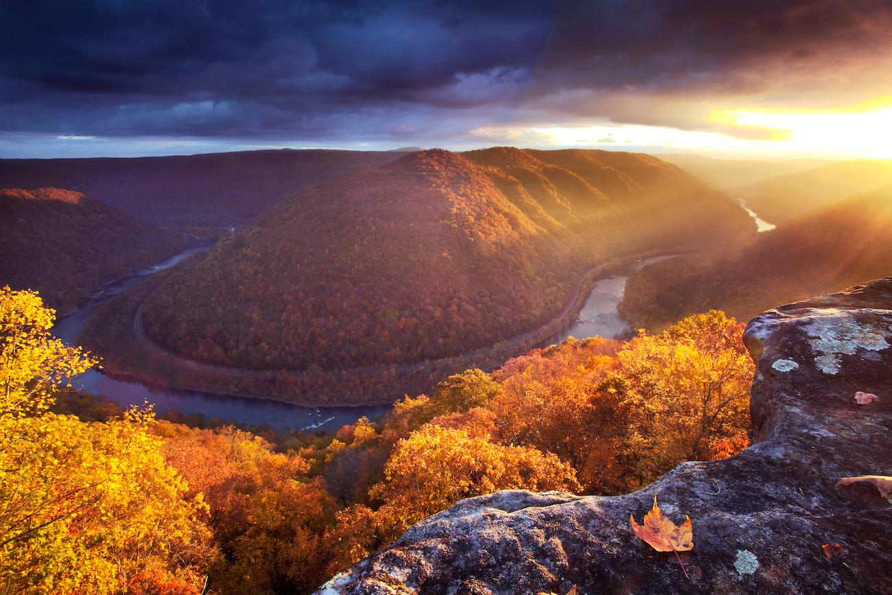 <p>PLACE: New River in West Virginia / DISTANCE: 300 miles southeast of Cincinnati, a five-hour drive / West Virginia's New River Gorge provides spectacular views year-round, but it is particularly dramatic during fall's explosion of colors. The Gorge has more than 100 species of native hardwoods including maple, beech, birch, oaks, ash, walnut, cherry, box elder, poplar, and elm. All of them contribute to the riot of fall colors. Head to Adventures on the Gorge adventure resort, grab a beverage, pull up a chair on their balcony, and enjoy the day. / Image courtesy of Adventures on the Gorge // Published: 10.19.19</p>