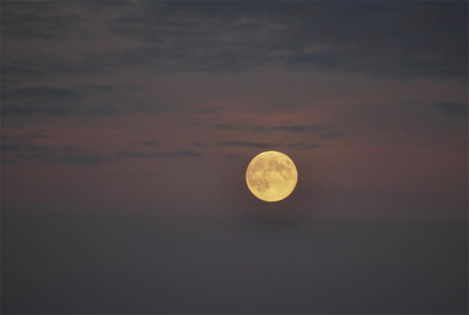 """Beautiful Moon Rise over Whidbey Island"" by Theresa Gonsalves."