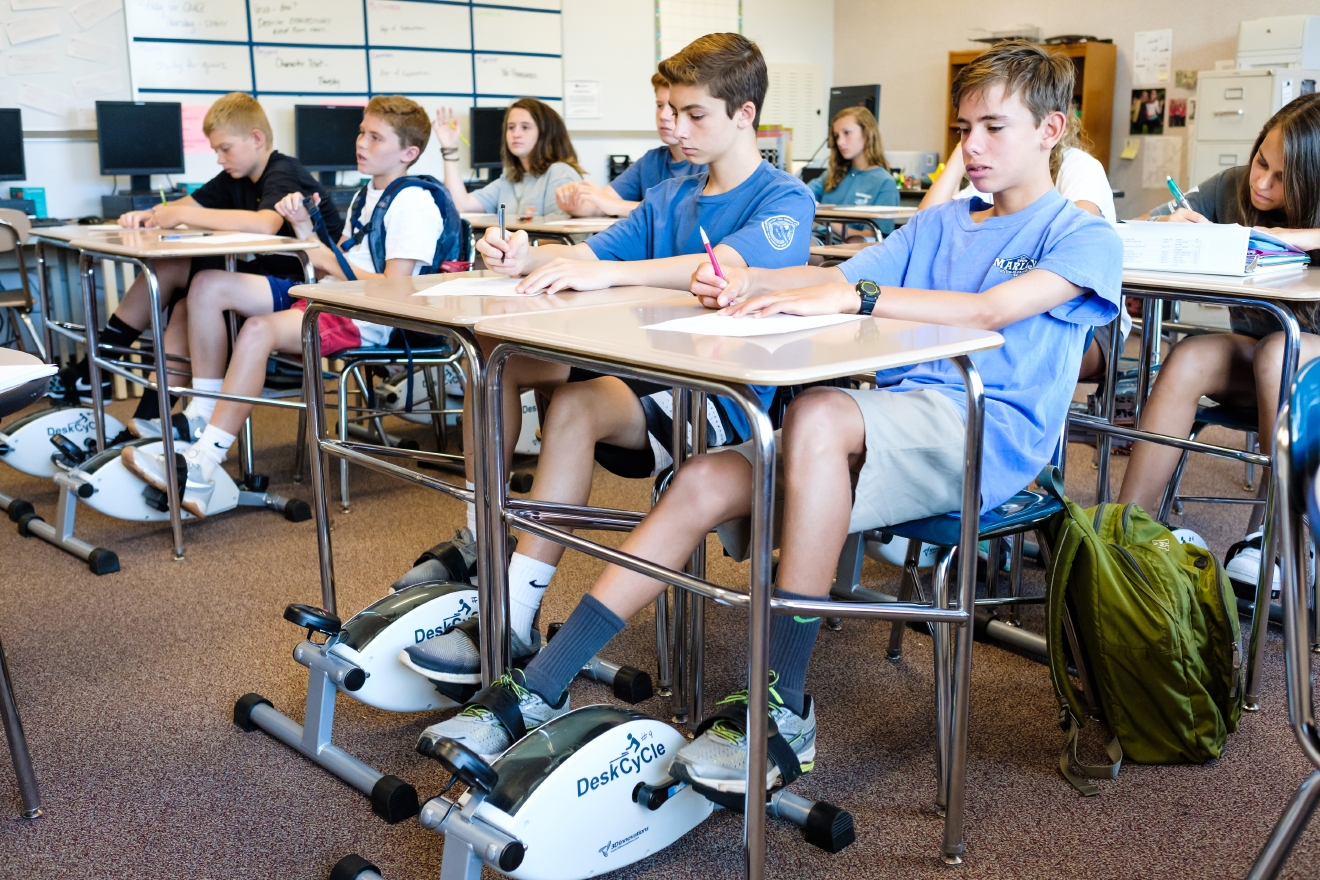 North Carolina eighth-grade math teacher Bethany Lambeth improves students' concentration with desk cycles. (Courtesy Paul Cory, Wake County Public School System via WENN)