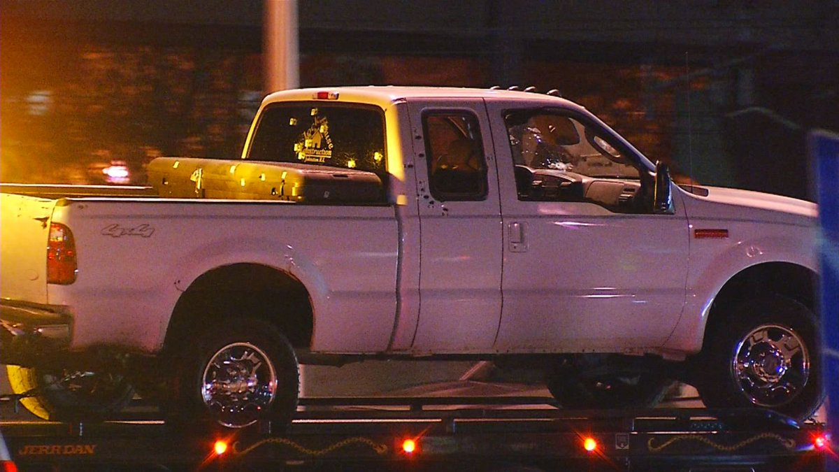The white pickup truck driven by Joseph Santos is towed away from the scene. (WJAR)<p></p>