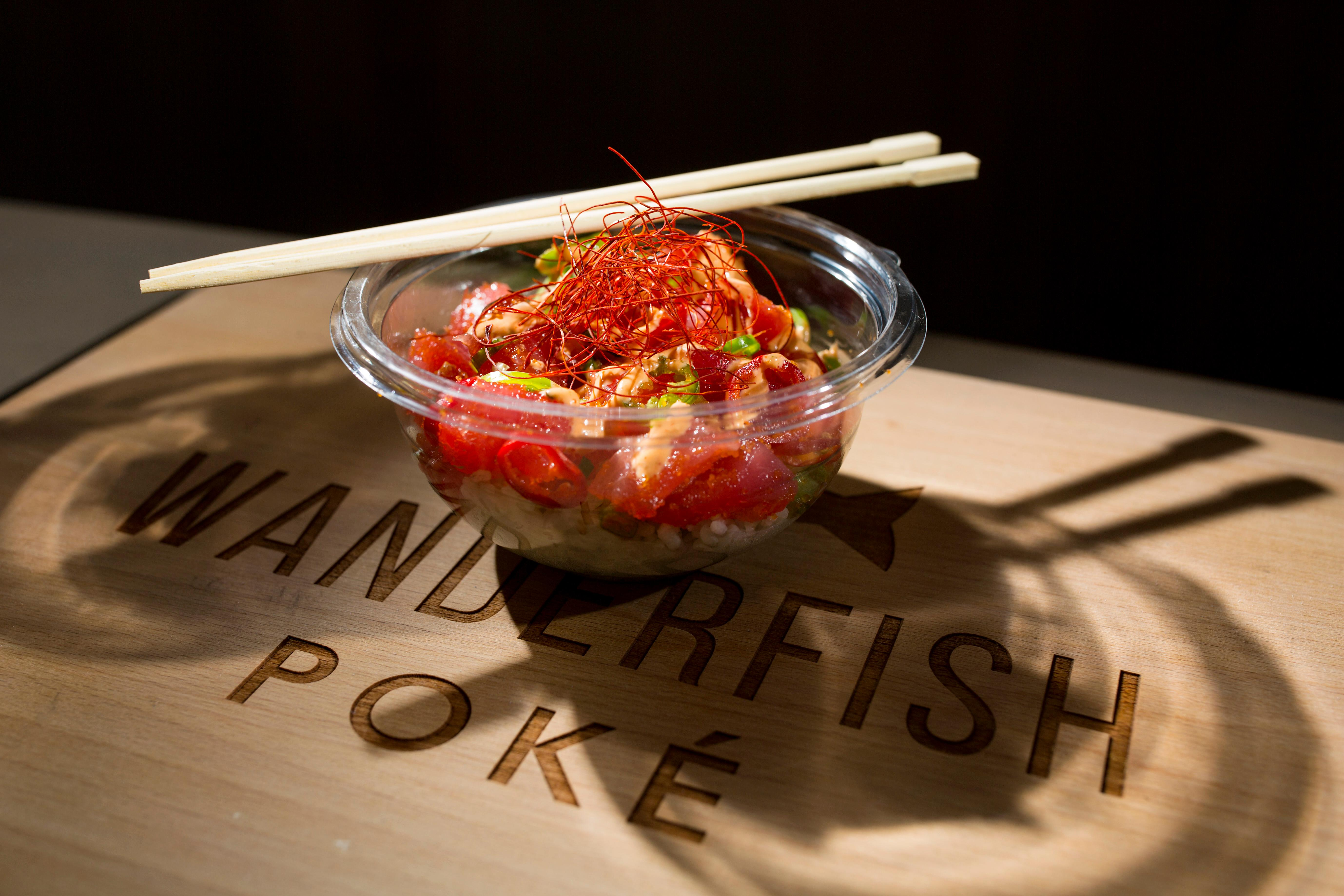 The Blaze Bowl at Wanderfish Poke, with wild Sockeye salmon, spicy aioli, jalapeno, green onions, fresno chili, masago, crisp garlic, and sesame seeds. All bowls at Wanderfish are customizable, with your choice of protein. (Sy Bean / Seattle Refined)