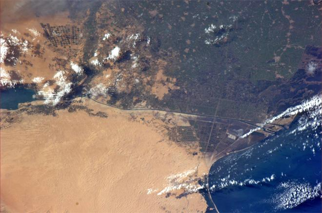"The Suez Canal, Egypt. Taken January 8, 2014."" The Mediterranean and Port Said are on the right (Photo & Caption: Rick Mastracchio, NASA)"