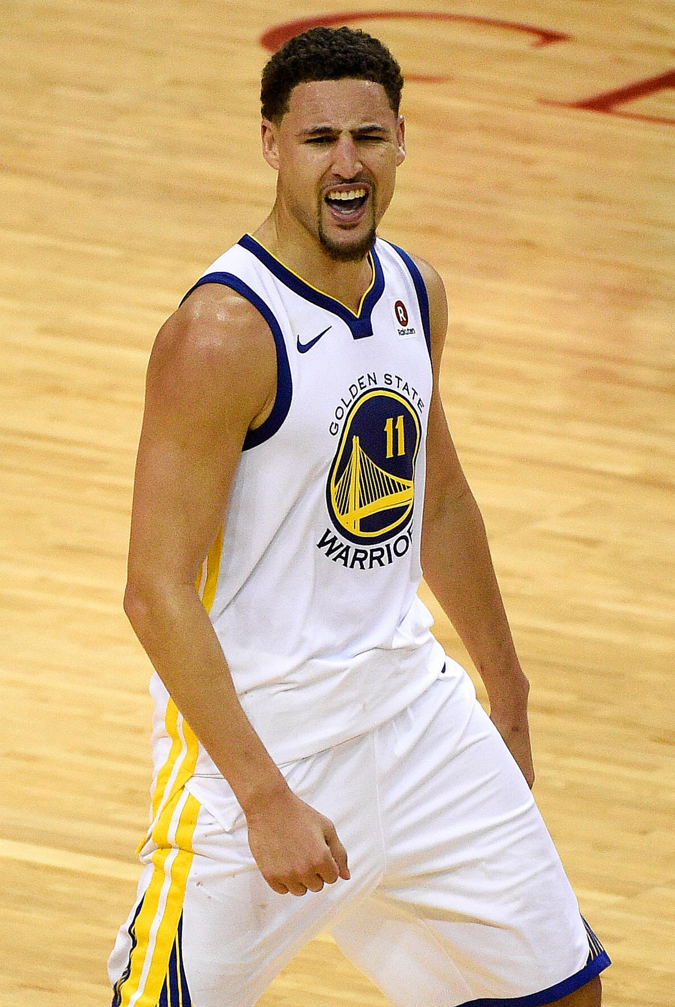 Golden State Warriors guard Klay Thompson reacts after a 3-pointer in the second half of Game 1 of the NBA Western Conference basketball Finals against the Houston Rockets, Monday, May 14, 2018, in Houston. (AP Photo/Eric Christian Smith)