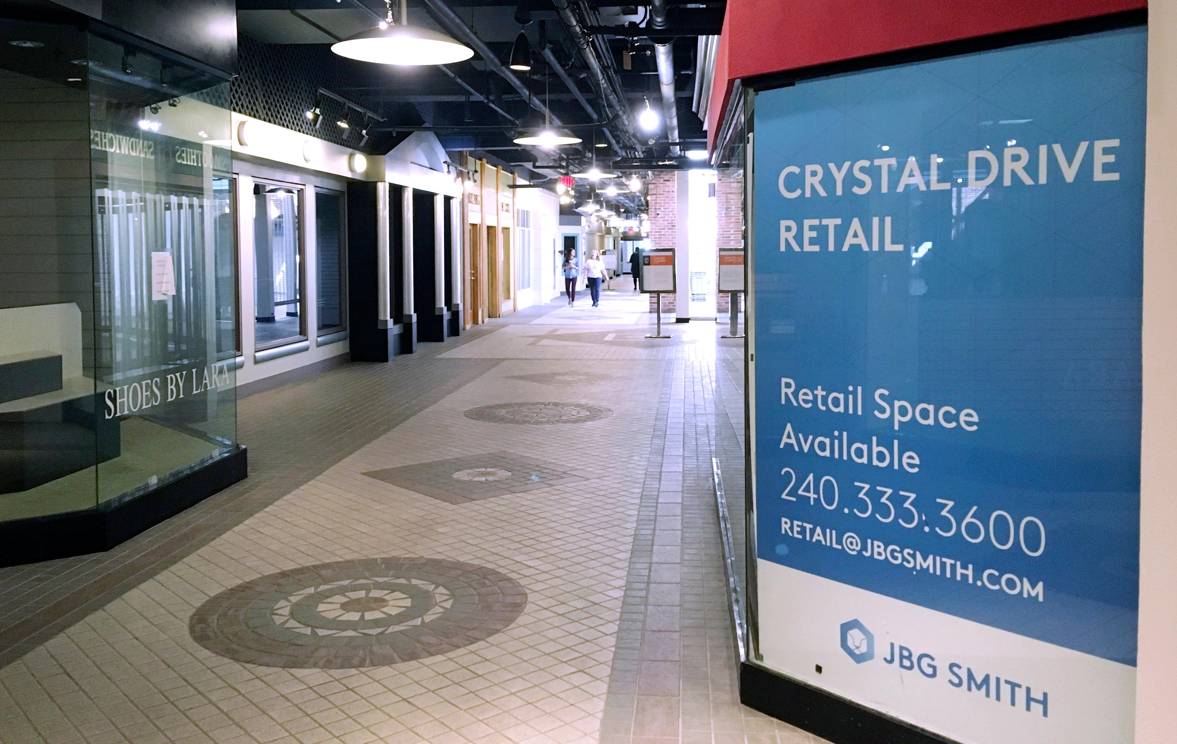 In this Thursday, Nov. 8, 2018, photo, pedestrians walk the underground corridors in Crystal City, Va. If any place in the U.S. is well positioned to absorb 25,000 Amazon jobs, it may well be Crystal City, which has lost nearly that many jobs over the last 15 years. (AP Photo/Matthew Barakat)