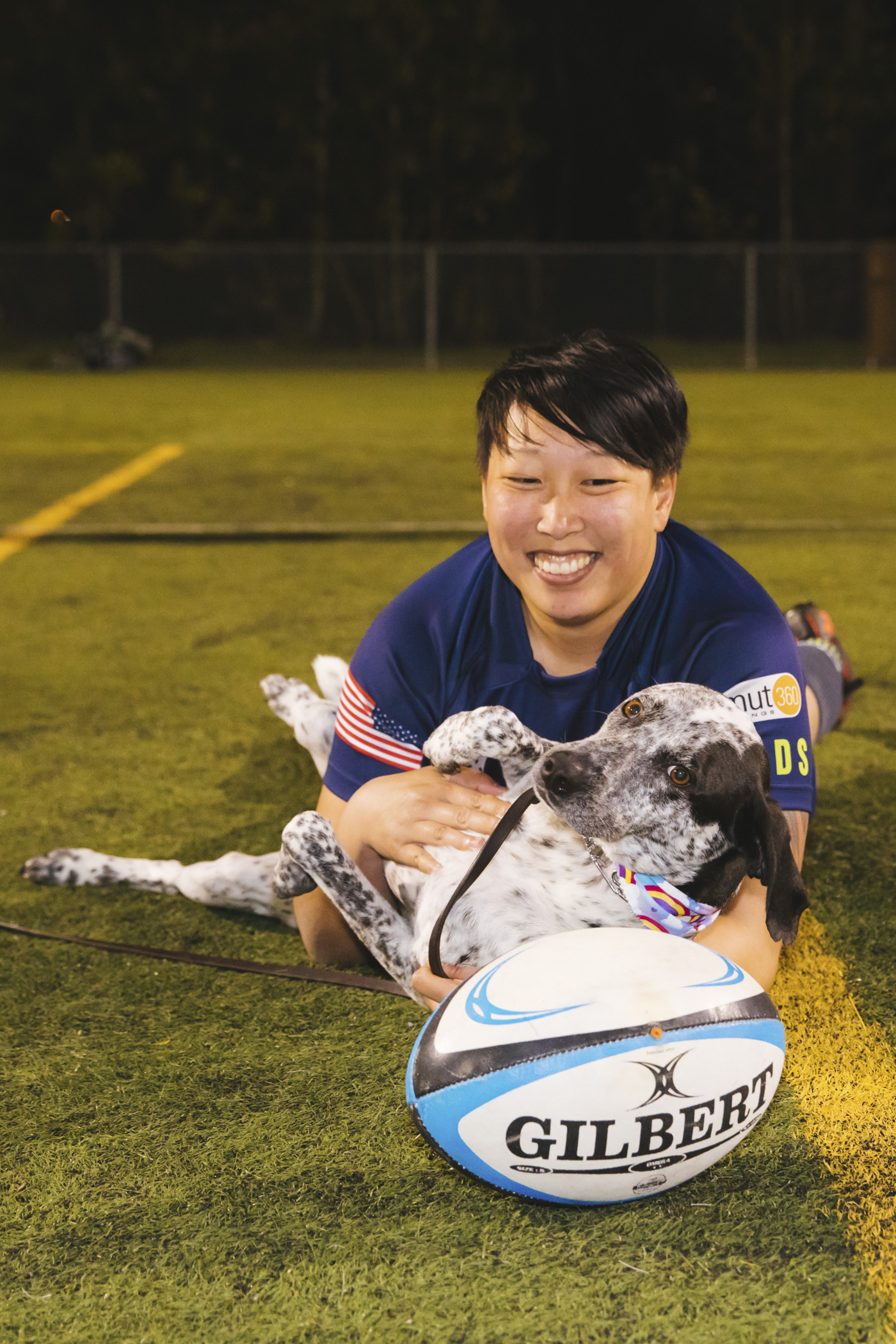 This is Lili and her sweet baby Odie. No, Odie does not play rugby but he might just be the best cheerleader of all time. Lili plays prop for the Saracens and her favorite snack is Pineapple.  Odie is five years young and is a Pointer. His favorite snack is anything off the counter.  (Image: Sunita Martini / Seattle Refined).