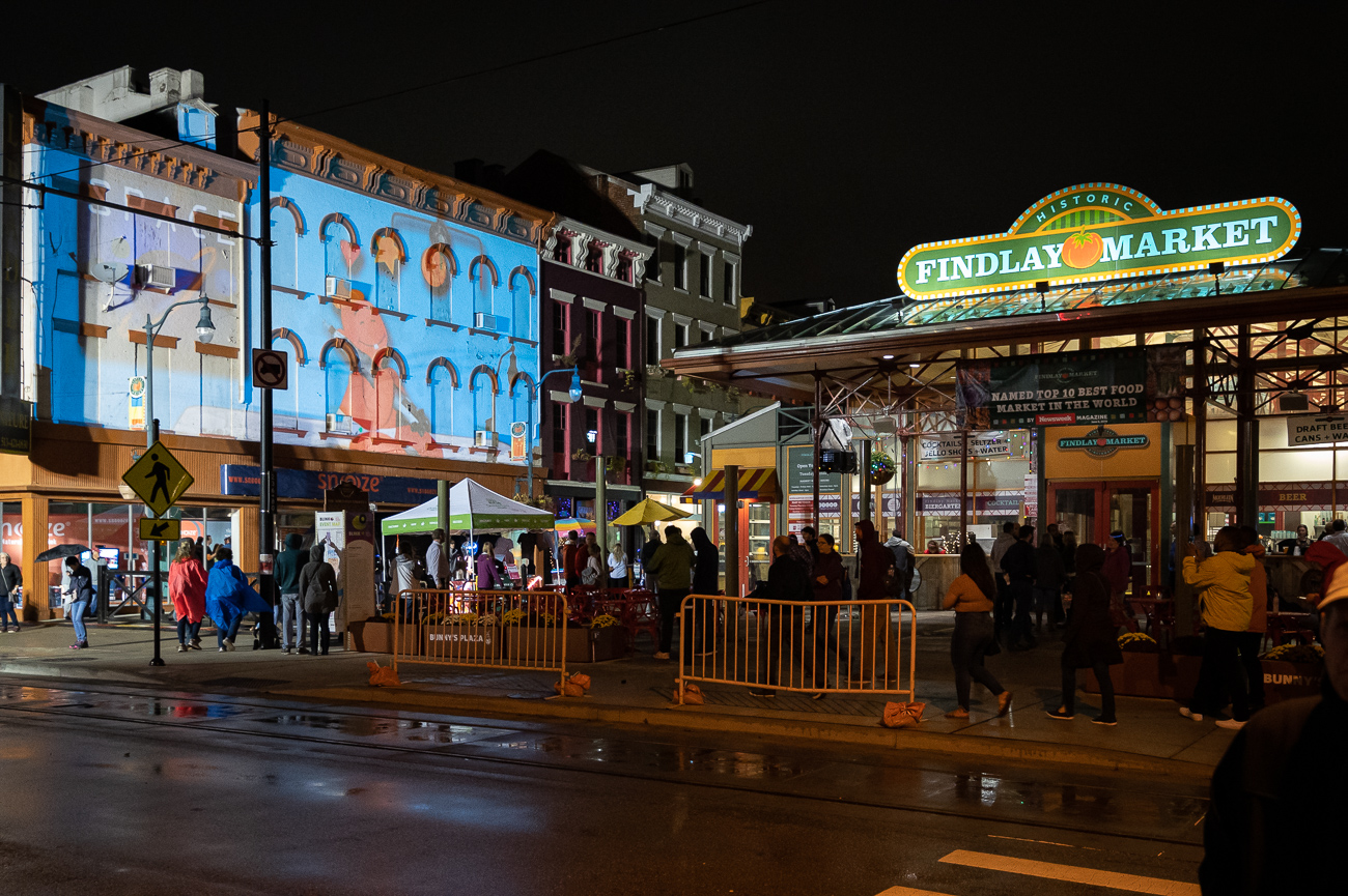 PICTURED NEIGHBORHOOD: Over-the-Rhine / Findlay Market is buzzing with activity thanks to two projections and a stage with live music. / Image: Phil Armstrong // Published: 10.12.19<p></p>