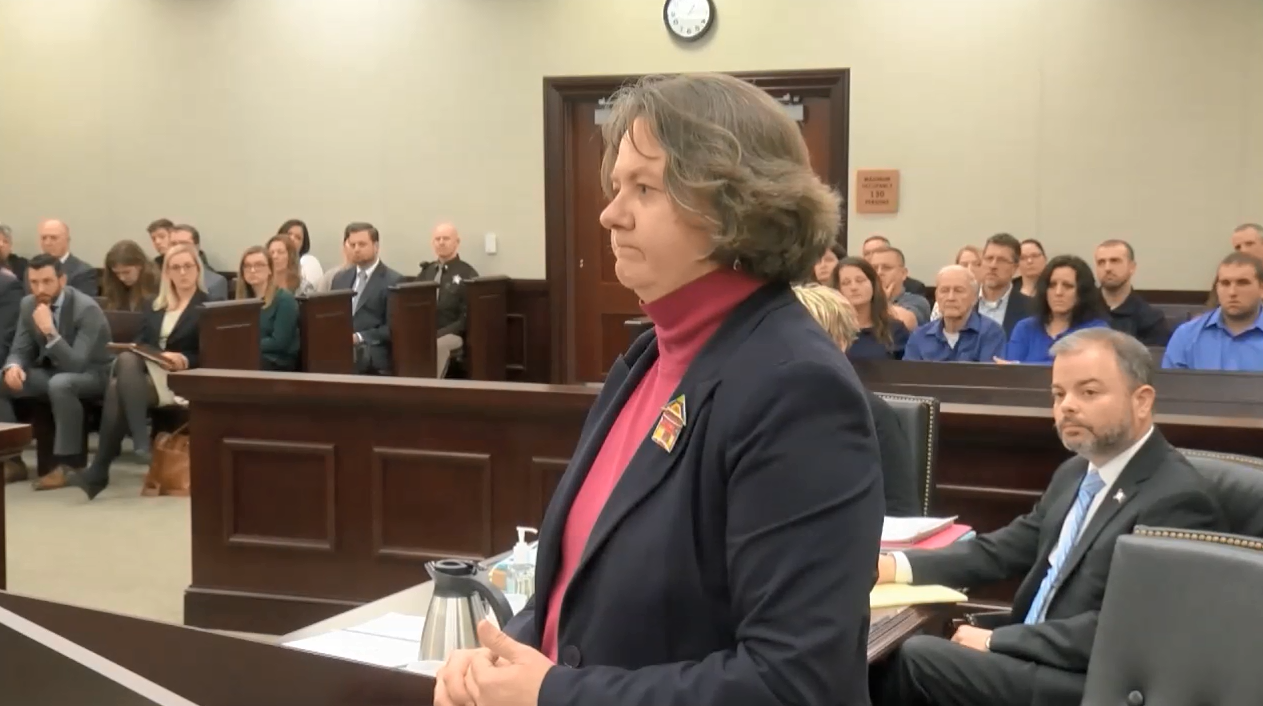 Commonwealth's Attorney Mary Pettit addresses the jury to begin her opening arguments comparing the evidence to a jigsaw puzzle. Pettit tells the jury, they will see different fragments of evidence, like pieces of a puzzle, but they must keep their eyes on the finished picture of the jigsaw puzzle.