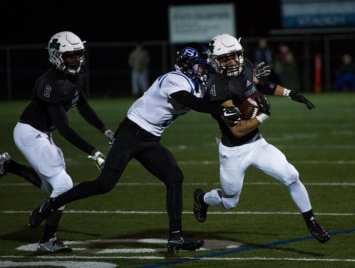 Sheldon Irish wide receiver Kimani Quade (#4) tries to shake off South Medford's Peyton Shipley (#5). The South Medford Panthers defeated the Sheldon Irish 31 – 14 at Sheldon High School on Friday, October 20. Photo by Kit MacAvoy, Oregon News Lab
