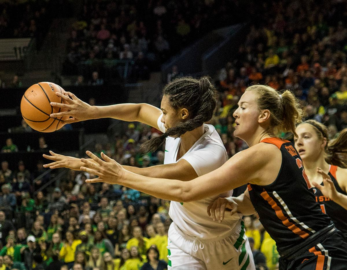 Oregon Ducks Satou Sabally (#0) passes the ball away from Beaver defense. The Oregon Ducks defeated the Oregon State Beavers 75-63 on Sunday afternoon in front of a crowd of 7,249 at Matthew Knight Arena. The Ducks and Beavers split the two game Civil War with the Beavers defeating the Ducks on Friday night in Corvallis. The Ducks had four players in double digits: Satou Sabally with 21 points, Maite Cazorla with 16, Sabrina Ionescu with 15, and Mallory McGwire with 14. The Ducks shot 48.4% from the floor compared to the Beavers 37.3%. The Ducks are now 7-1 in conference play. Photo by Rhianna Gelhart, Oregon News Lab