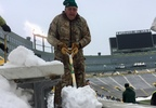 A shoveler works on clearing Winter Storm Abigail's snow out of Lambeau Field Dec. 18, 2017.