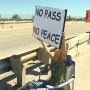 Protesters demonstrate against closure of Rollover Pass