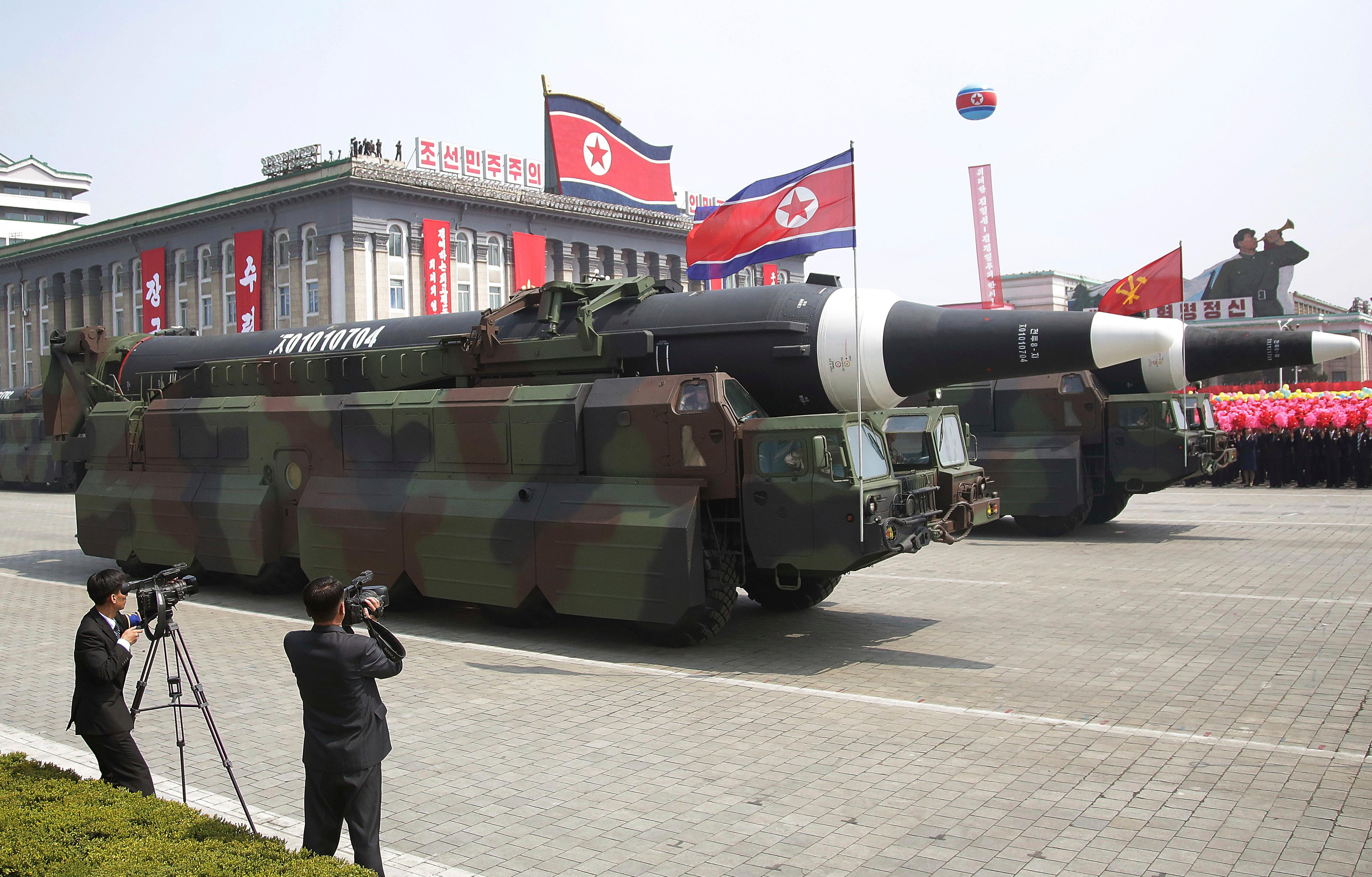 In this Saturday, April 15, 2017, file photo, what analysts believe could be the North Korean Hwasong 12 is paraded across Kim Il Sung Square during a military parade in Pyongyang, North Korea. Threatening to fire a volley of missiles toward a major U.S. military hub _ and the home to 160,000 American civilians _ may seem like a pretty bad move for a country that is seriously outgunned and has an awful lot to lose. But pushing the envelope, or just threatening to do so, is what North Korea does best. (AP Photo/Wong Maye-E, File)